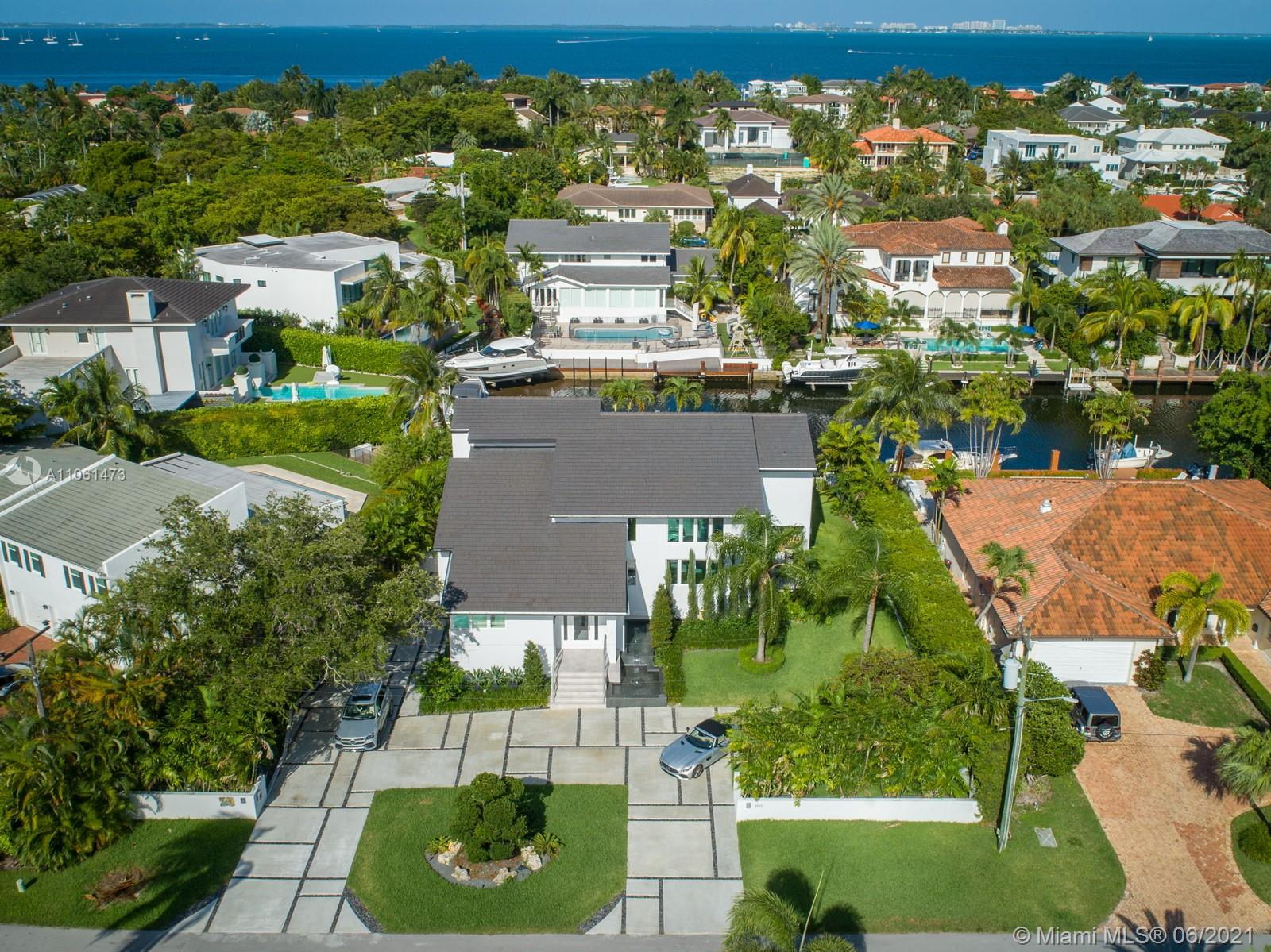 Sunshine, sea breezes and direct ocean access with no bridges to the Bay!!! Enjoy an incredible waterfront Miami lifestyle in this impeccably remodeled 5 bed/5 bath contemporary smart home complete with a 100 ft seawall & boat lift on a wide canal in the guard gated, upscale community of Sunrise Harbour in Coral Gables. From the floors to the roof, everything has been replaced including plumbing, electrical, glass wine room, Italian chef's kitchen and impact glass throughout with pocket sliders that open completely to the terraces & pool inspiring indoor/outdoor entertaining. Features water views, a gym, garage, 2300+ sf of storage and premium location minutes from the Grove, South Miami, great schools and int'l airport. Start the best chapter of your life TODAY in this move-in ready home.