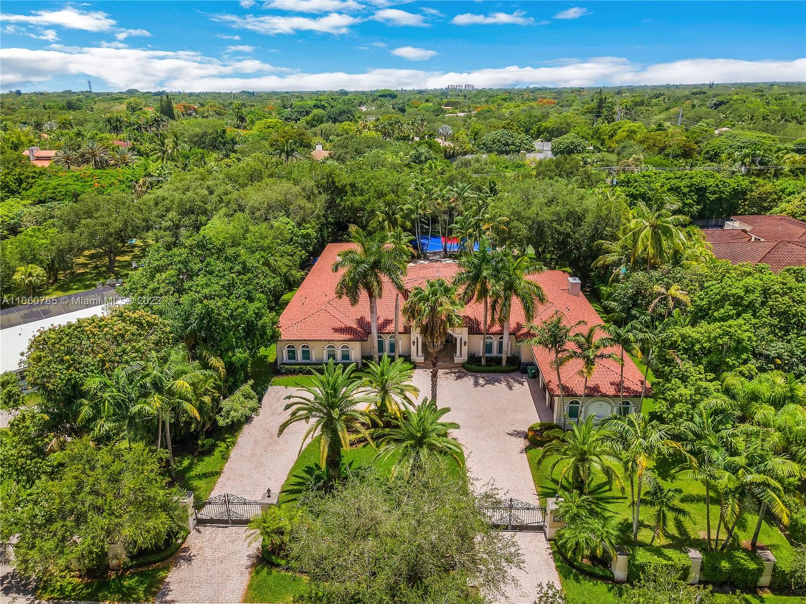 Stunning 1-story home recently remodeled in NE Pinecrest! This home sits on over 1 acre with a half court for the NBA enthusiast. Plenty of privacy with hedges surrounding the property and electric gate at entrance. 3-car garage, 6 bedrooms on one side of the home and an additional service/guest room on the opposite side, laundry room, remodeled kitchen and bathrooms, etc. The perfect home for a large family that wants to be minutes from the best schools Miami has to offer.