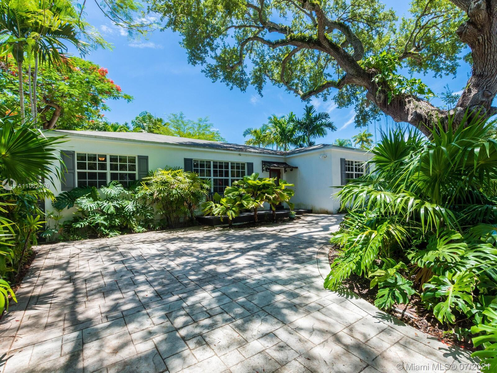 SELLER MOTIVATED with over $230,000 in upgrades! Step into this delightfully renovated North Coconut Grove home. Enjoy the best of the charming Grove lifestyle with everything that you need including a new roof, impact windows, new plumbing, chef's kitchen with a gas stove, stainless steel appliances and gorgeous hardwood/ Spanish tiled floors. This home boasts an open floorplan, an exceptional lot size and a luxurious backyard private oasis. The location is unbeatable with a short 5-minute drive from Brickell. Walk everywhere from this home from parks to restaurants. This home can easily be expanded to fit your design interests and even a second floor can be added to maximize value. The lot has plenty of room for a pool surrounded by lush landscaping - an entertainer's dream come true.
