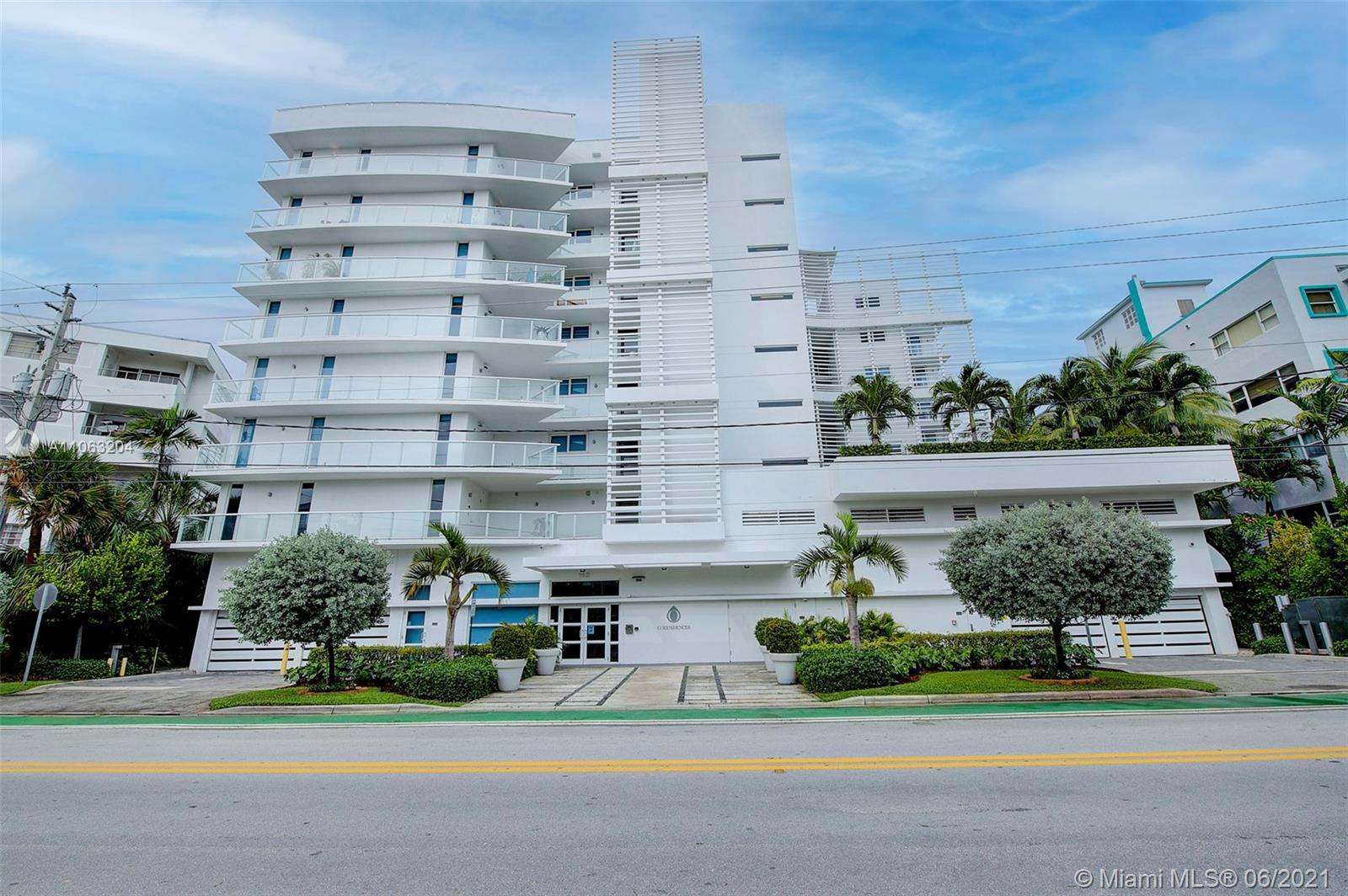 """O Residences is a boutique condo building located on a waterfront lot in Miami Beach's Bay Harbor Islands. The 9-story building offers 41 exclusive condos, with only 6 residences per floor. Located near the Bal Harbour Shops and Bal Harbour Beach. This waterfront condominium feature floor-to-ceiling glass, glass-paneled terraces, marble flooring and """"smart"""" technology. The kitchen offers Italian-style cabinetry, stainless-steel appliances and natural quartz countertops. O Residences Bay Harbor Islands offers resort-quality amenities and attentive services. Residents enjoy a third floor amenity deck, with a zero-edge sunset pool, infinity hot tub and cabanas. O Residences also features a bayfront water deck, a state-of-the-art fitness center, a waterfront summer kitchen, a boat dock"""