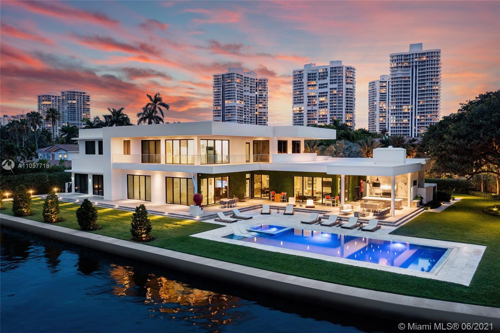 This modern tropical oasis is situated on an expansive 36,136 SF lot, one of the largest in Golden Beach. On a wide canal with breathtaking water views, this estate is the perfect balance of modern architecture, privacy & the ultimate family living experience. Boasting 14,639 SF of open concept luxurious living, 6BD/7+3BA, 3 car garage & an expansive driveway. Complete w/ private gates, floor-to-ceiling windows, heated saltwater pool, summer kitchen, custom high-end finishes, gourmet kitchen, wine cellar, elevator, gym, movie theatre, soaring double height ceilings, principal wing w/a boutique style walk-in closet. The serene outdoors face the tranquil 280' of waterfront & include a private dock & jet ski lift. This custom home is impeccably maintained with no expense spared.