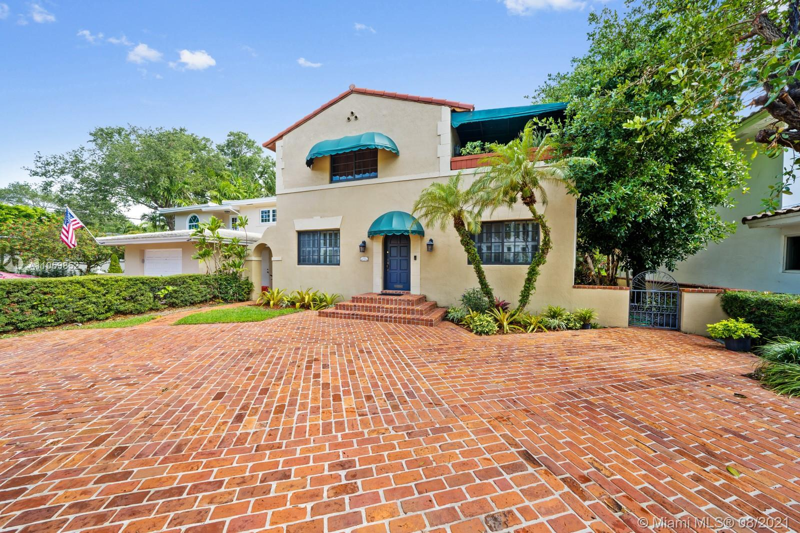 1925 Old Spanish located in South Coral Gables walking distance to the University of Miami and Riviera Golf Course. The large Chicago brick circular driveway welcomes you to this 4 bedroom 2 bathroom home. Partially equipped with impact windows, roof was replaced in 2014, 2017 water heater and washer/dryer, septic tank emptied and inspected 2019, and A/C installed 2016. The lower level has one bedroom and one bathroom, formal dining room, living room, family room, breakfast nook or office, laundry room and kitchen. The upper level containing 3 bedrooms and 1 bathroom with a large balcony located outside the primary suite. YARD HAS ROOM FOR A POOL.