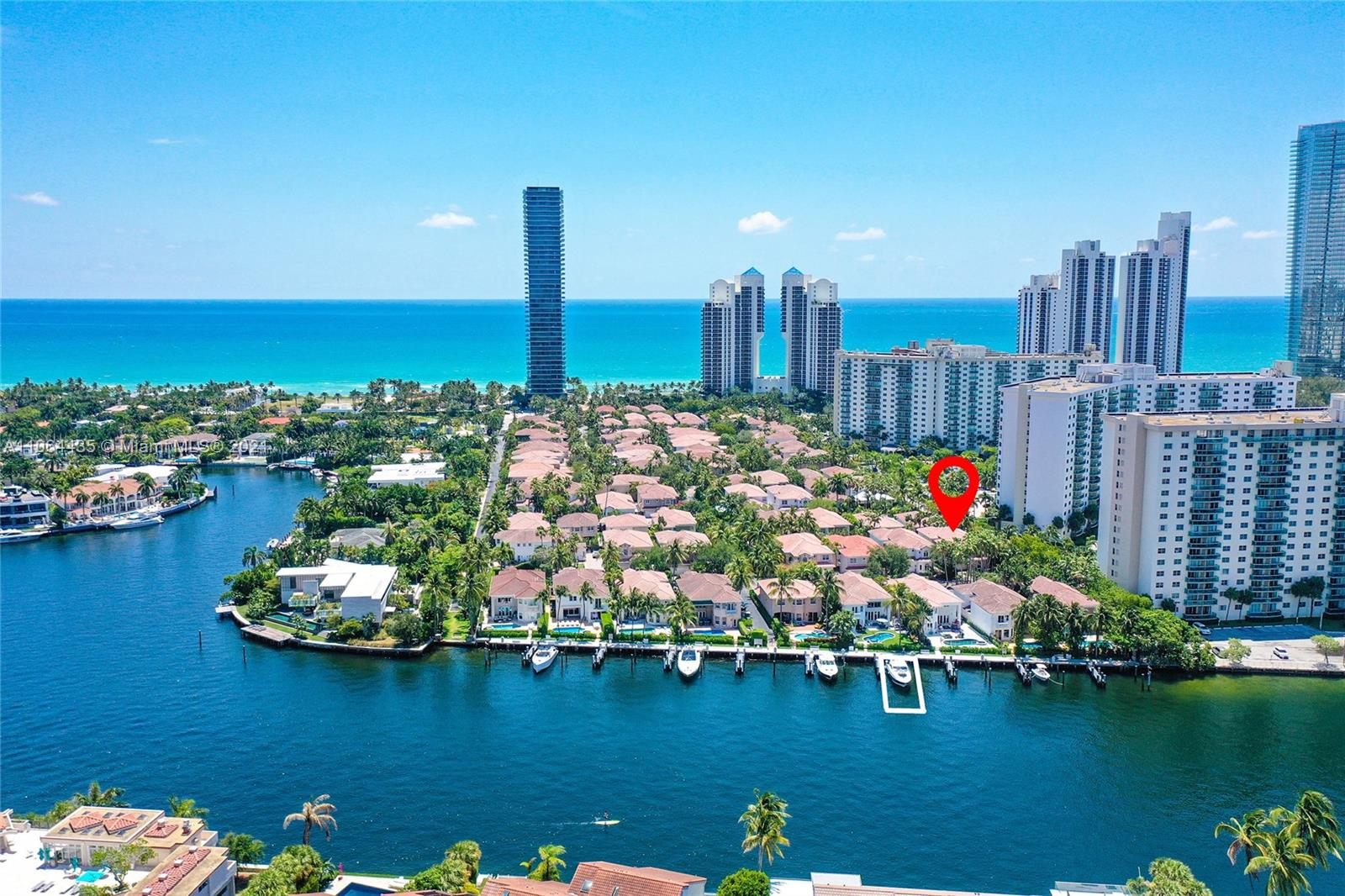 Prime location + a spectacular home including a deep water PRIVATE BOAT DOCK, walking distance to the beach = an amazing lifestyle opportunity!! Welcome to this fabulous, unique two story courtyard home with a private marina, located in prestigious Golden Gate Estates and Marina, the only gated & 24 hours guarded waterfront single family homes community in Sunny Isles Beach. This fantastic Estate just shy of 3500 SF of LA seats on a 7172 SF desirable cul-de-sac corner lot, featuring a luxury size full sunny pool & beautifully manicured outdoor area/double height ceilings/5bed/4.5bath/formal dining & living/family room/open kitchen/den-office space/2 car garage/elegant finishes such as marble floors, designer custom work throughout/lots of natural light and privacy.