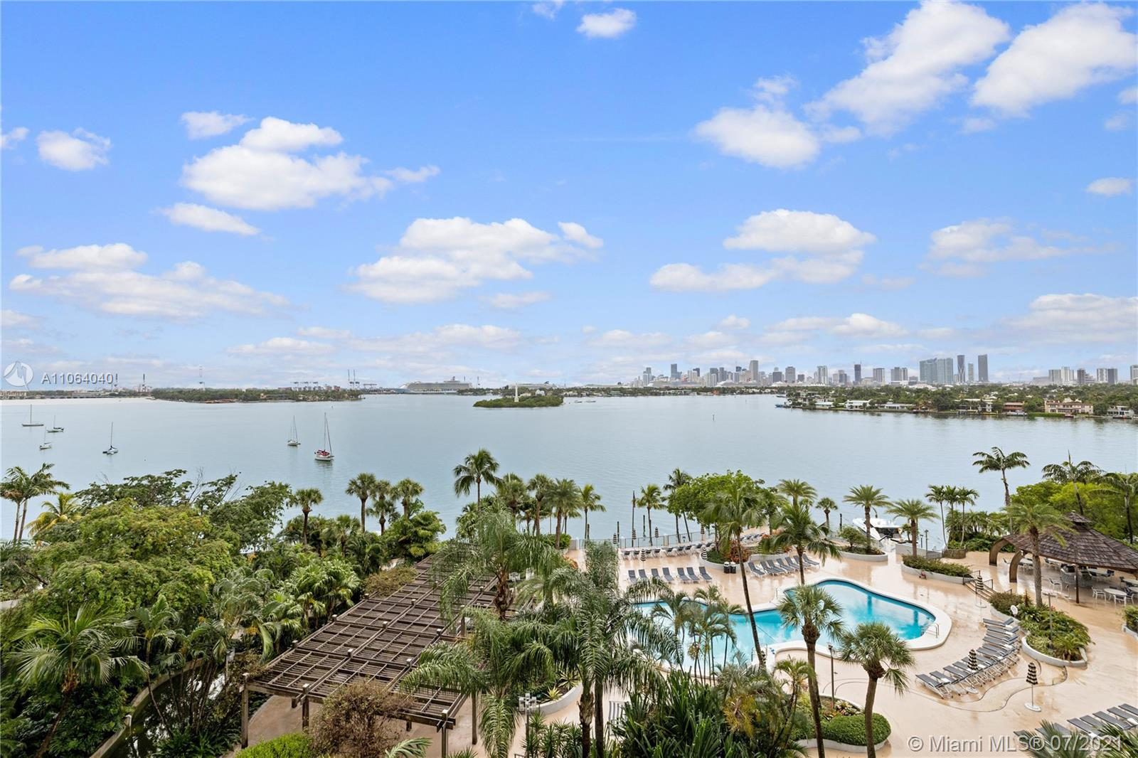 Enjoy stunning sunsets from this lovely 2 bedroom/2 bathroom unit - 100% completely updated - including new impact windows. New open kitchen with granite counters. Full sized washer/dryer w/ laundry room, tons of storage. Full service established building with LUX amenities: security, concierge, tennis, heated resort-like pool & 3 Jacuzzi overlooking the bay & downtown, valet, gym, BBQ area, party room, boat slips. Children's park + 2 dog parks in front of building. Walking distance to The Standard, Sunset Harbor, Linciln Road, shops and trendy restaurants.