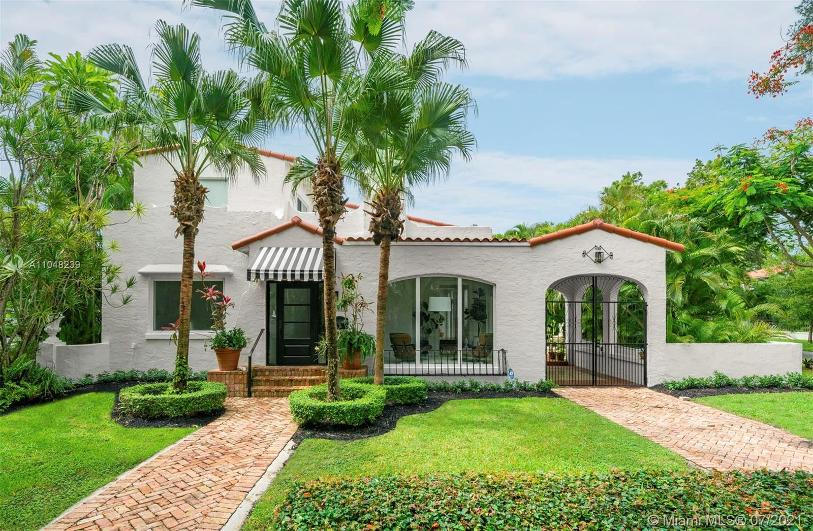 This 3,433 Sq. Ft. Spanish Colonial 4-bedroom 2-bath home in Coral Gables is in a peaceful location close to schools, parks, the Granada Golf Course, and world-class shopping and dining. Offering beautiful and light-filled indoor spaces, the home includes a living room with a wood-burning fireplace, upgraded kitchen, dining room and family room. The captivating second-floor main suite has a modern en-suite bathroom with dual sinks and a frameless glass shower. Other highlights include high-impact windows and doors, hand-cut Italian tile and newly refinished wood floors. Outdoors you will find a lagoon-style pool, patio, and the guest house, which has 2 bedrooms, 1 bathroom, living room, kitchenette, and a separate entrance from Cordova Street.