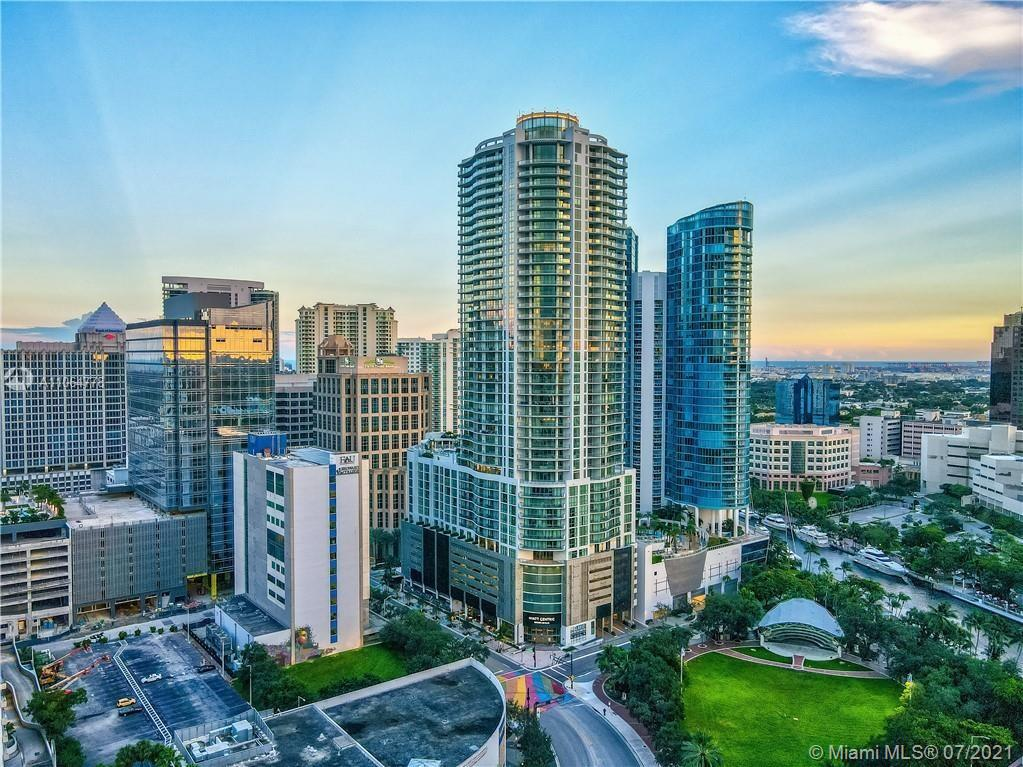 """VIEWS to EVERYWHERE - Live the LUXURY LAS OLAS LIFE that you've dreamed of - Relax on the HUGE balcony as the SUN SETS over the BEST views of the RIVER in the county, its perfect for wine-down time; or sip morning coffee watching the SUNRISE over the OCEAN VIEW on the second East balcony, this is PERFECTION. This is the most popular """"D"""" model featuring 2 large Split Bedrooms, 3 baths PLUS a DEN (can be an Office, 3rd Bedroom, or living space). Top of the line finishes. New motorized shades in every room! New double-hang closets added. Come home & unwind at the height of elegance; a unique address planned for the way sophistication is meant to be lived. Resort Style Amenities - PET FRIENDLY (big dogs too). Shopping, dining, entertainment is right outside your door. This building is a 100 !"""