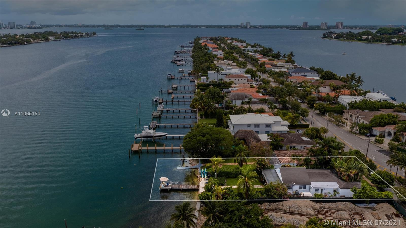 This beautiful and spacious home at 2,015 SQF of living space built on lot of 8,800 SQF, offers the ultimate in waterfront Miami living in gated prestigious Stillwater Drive community in Biscayne Point area. Fitted with wood, tile, marble floors throughout, floor to ceiling windows, amazing views of the water from living room, dining, and kitchen areas, cozy outside setting, excellent for entertainment, with instant access to the bay, intercoastal and ocean. Set in amazing tropical landscape, perfect for paddle boarding, kayaking, and all water sports, walking distance to beach, centrally located between Bal Harbour and South Beach and minutes to the best restaurants, entertainment, and shopping in town. Great opportunity to purchase a waterfront home & live in a sea, sun & sand paradise!