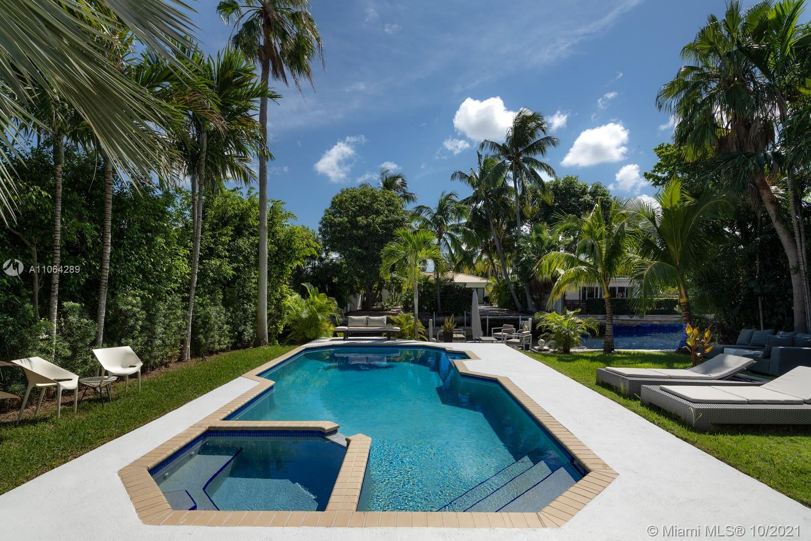 Your mid-century modern tropical oasis awaits you. Must-see 3 bd/2.5 ba waterfront sanctuary located in exclusive gated community of Biscayne Point, Miami Beach. The current residence feats. 2,700 living sf on an impressive 9,000 sf lot, 60 ft of waterfrontage, a 30 ft salt pool/jacuzzi/bbq area, 15 ft dock with 2 Yamaha WaveRunners & ports. The distinguished architecture boasts Miami Beach elegance, as the foreseen renovation plans designed by famed architect Kobi Karp, will enhance the property's historic attributes and increase the sq footage to 5,000. Newly renovated custom bath w electric toilet and the kitchen is currently under a $100k renovation with top-of-the-line Wolf & Sub-Zero appliances.