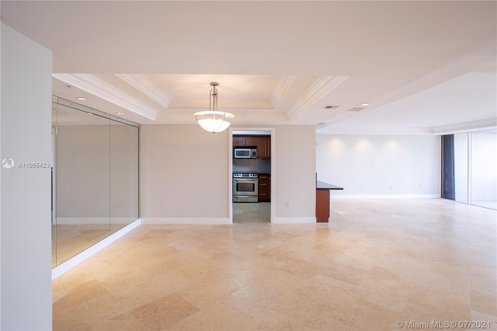 Live on a private gated island in the heart of Miami. Water views from every room. This 2/2 is large and comfortable. This condo has been updated and includes surround sound speakers, marble bath, granite kitchen counter, beautiful mill work, electric window blinds, custom closets and so much more. The community offers marina, gym, walking path, bay access for paddle boards and water enjoyment. It also has tennis courts, movement room, bicycle storage, climatized additional storage and comes with two parking spaces. New assessment started July $192.00/mo. It's a lifestyle and a condo in one!!