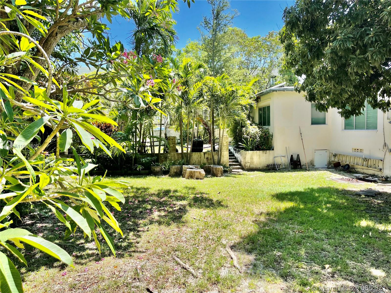 ELEVATION AND LOCATION! Perfectly situated 20 feet high on the coral rock ridge (Miami's highest point) is this intact 1400 sq ft 1940's  bungalow on very large lot (9375 sq ft). Truly the best of both worlds, less than 1/2 a mile to magical Biscayne Bay, (yet not in a flood zone) marinas, watersports, Monty Trainer's and Starbucks. And also in the opposite direction less than 1/2 mile to the Metrorail with direct routes to the airport, Brickell, the heart of downtown Miami, Coral Gables, U.M., Dadeland and beyond. Renovate and add on to the small existing house which  or build a big new dream house! Showings of outside only until the open house on Sunday July 11 th 1:00-4:30 Showings of the lot only by appointment and then an open house will be held on Sunday July 11th from 1:00 - 4:30.