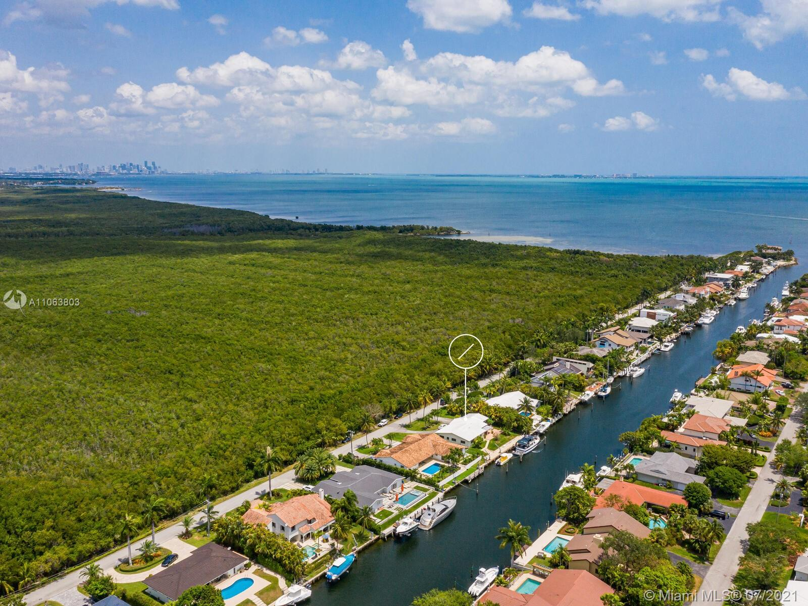 Big Opportunity knocks in Gables by the Sea!  Direct Ocean Access to Biscayne Bay from 100' private seawall. Bring your contractor or architect and make your dreams come true with renovations or new build on 11,500 SF Lot. Current ranch style 1964 home last sold in 1976.  Located on quiet Lugo Ave on the wide Lugo canal with plenty of room for your big yacht.  This cute 2539 Adj SF home has 3BD and 2BA with tons of potential. Two-car garage, circular drive, peaceful water views and nice floor plan. Gables by the Sea community is 24/7 guard-gated with a voluntary HOA. All top-rated schools and A+ municipal services.  Well situated in the City Beautiful, Coral Gables, with a neighborhood park, pedestrian-friendly tree-lined, low-traffic, closed-end family friendly streets. Truly Paradise!