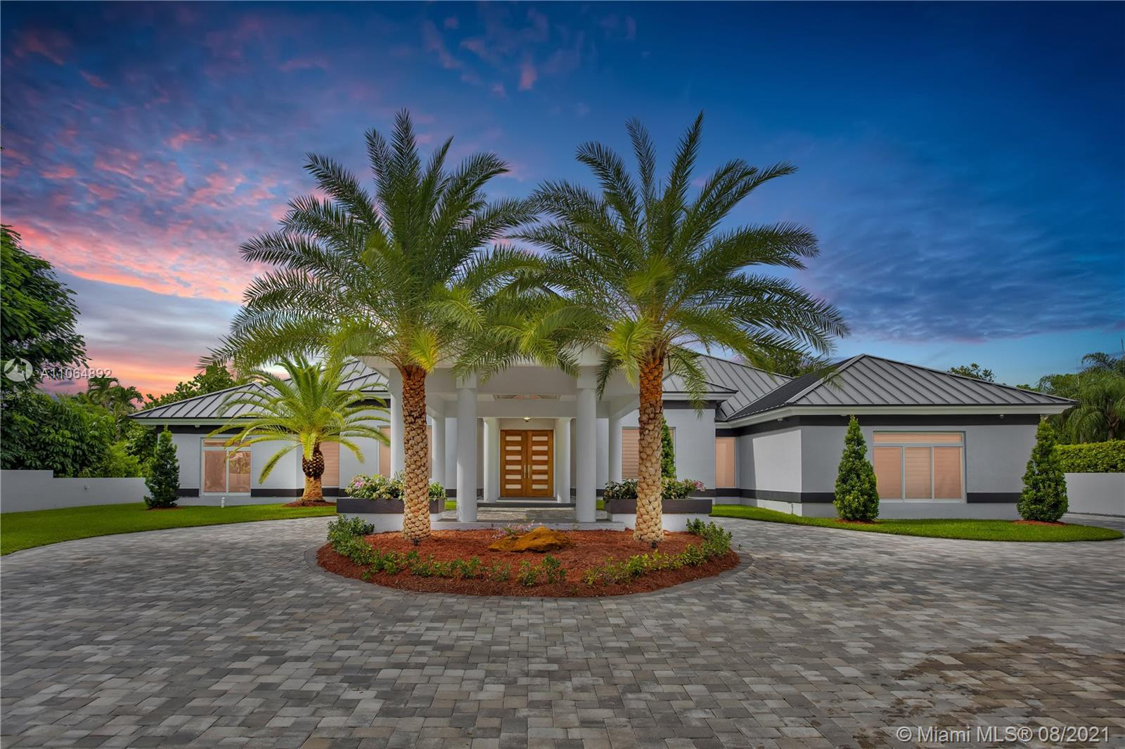 Completely remodeled in 2020 modern Pinecrest Estate 6/6.5 with top of the line features. Everything new including elec, plumbing, metal roof, 5 a/c units, heated pool/spa, 8ft Italian interior doors, vaulted ceilings, impact doors/windows, tankless water heater, air conditioned 3 car garage. New kitchen with high end appliances, wood cabinets, quartz countertops & oversized island along with a 58 bottle wine cooler is perfect for entertaining.  Master suite has adjacent private bonus room w/ private garden! Dome gazebo is surrounded by a pond with a relaxing cascading waterfall, perfect for friends & family gatherings. Maids quarter. Smart home, control everything from the app, including alarm & camera system! Excellent Pinecrest schools nearby including Gulliver, Westminster, St. Thomas.