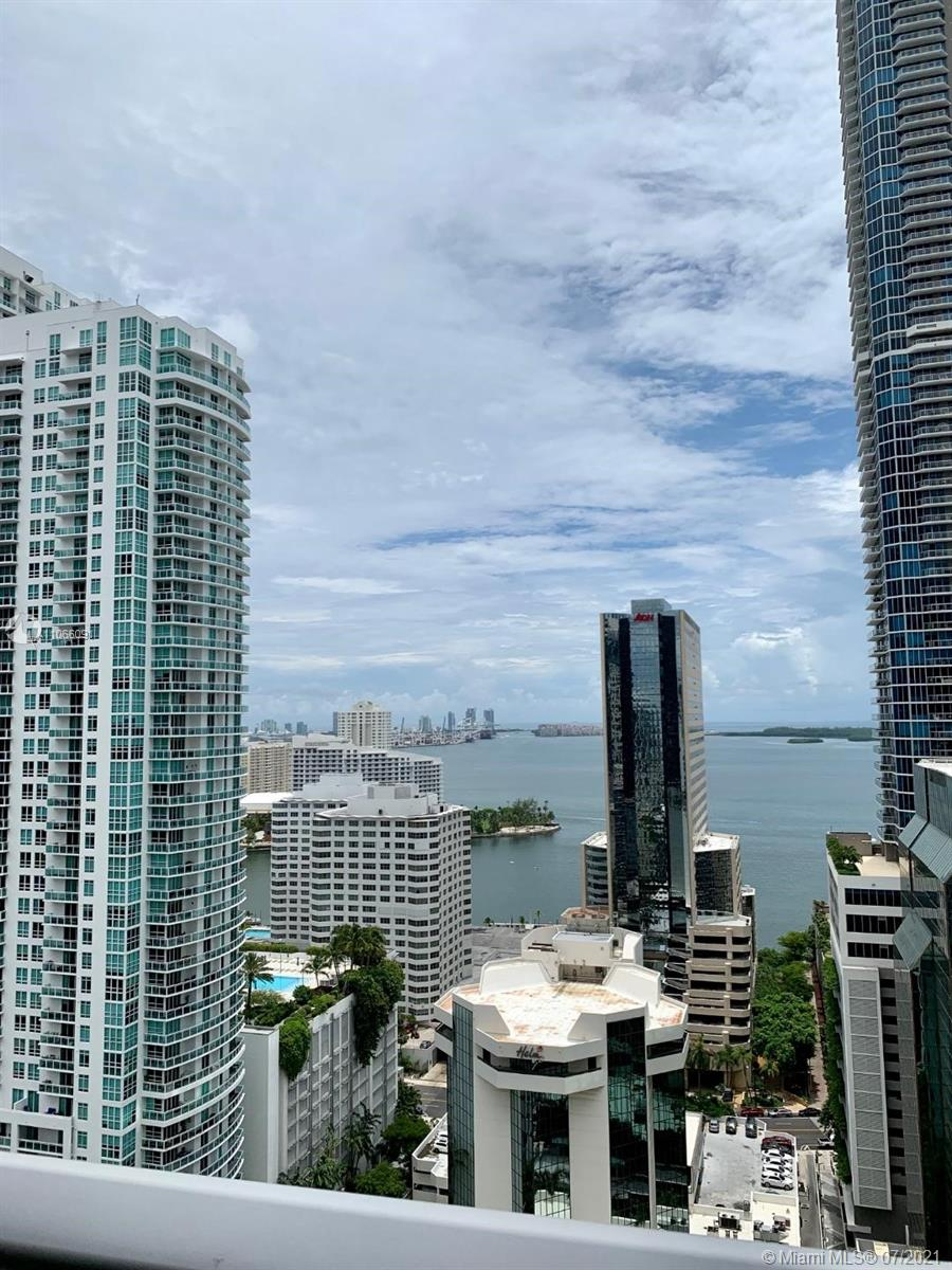 Enjoy the fantastic view from this beautiful, furnished 2/3 at 1010 Brickell! This unit comes with stainless steel appliances in its open kitchen, marble floors, both bedrooms with bathrooms en suite, large balcony plus private balcony in master, high ceilings, washer & dryer in unit, private elevator, 2 COVERED parking spaces plus Den.  1010 Bickell offers: 24 hour security, fitness center, roof top swimming pool on 50th floor, Hammam spa, basketball & racquetball courts, indoor heated swimming pool, playroom and more. Walk to work or play at this excellent location next to public transportation, shopping & dining. Call listing agent or use showing assist.