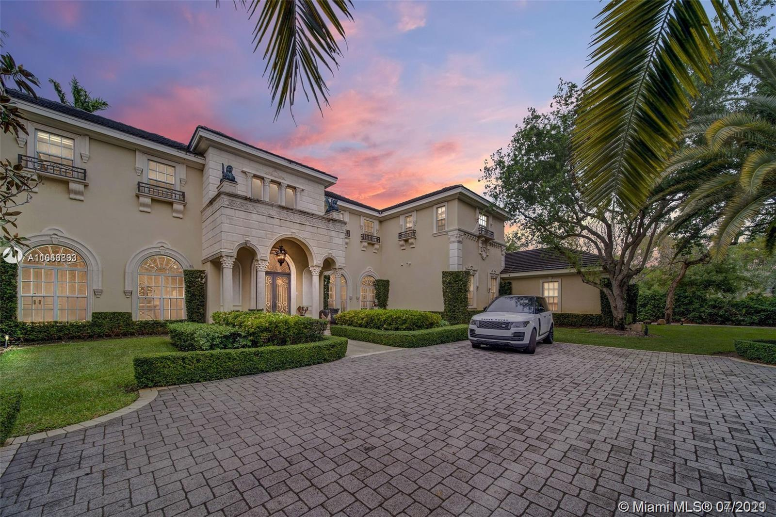 Hidden masterpiece in North Pinecrest! Nestled on a quiet street, this estate boasts exquisite designs & features over 9,000 sqft of glorious living space. Highest quality finishes include imported marble, commercial elevator, impact windows/doors, full Home Generator, theater & soaring ceilings. Enjoy natural light that spills in from the windows enhancing the beautiful architecture & arched halls. Ideal floor plan including open kitchen to an oversized family room, 1st floor junior master suite, in-law/maid quarter plus Rosewood adorned study. Upstairs Master suite is tucked away from all the other suites for ultimate privacy. The remaining 4 suites are greeted via a spacious loft.  Gated, breath-taking grounds & pool/patio area including a Versace inspired pool design.  Original owner!