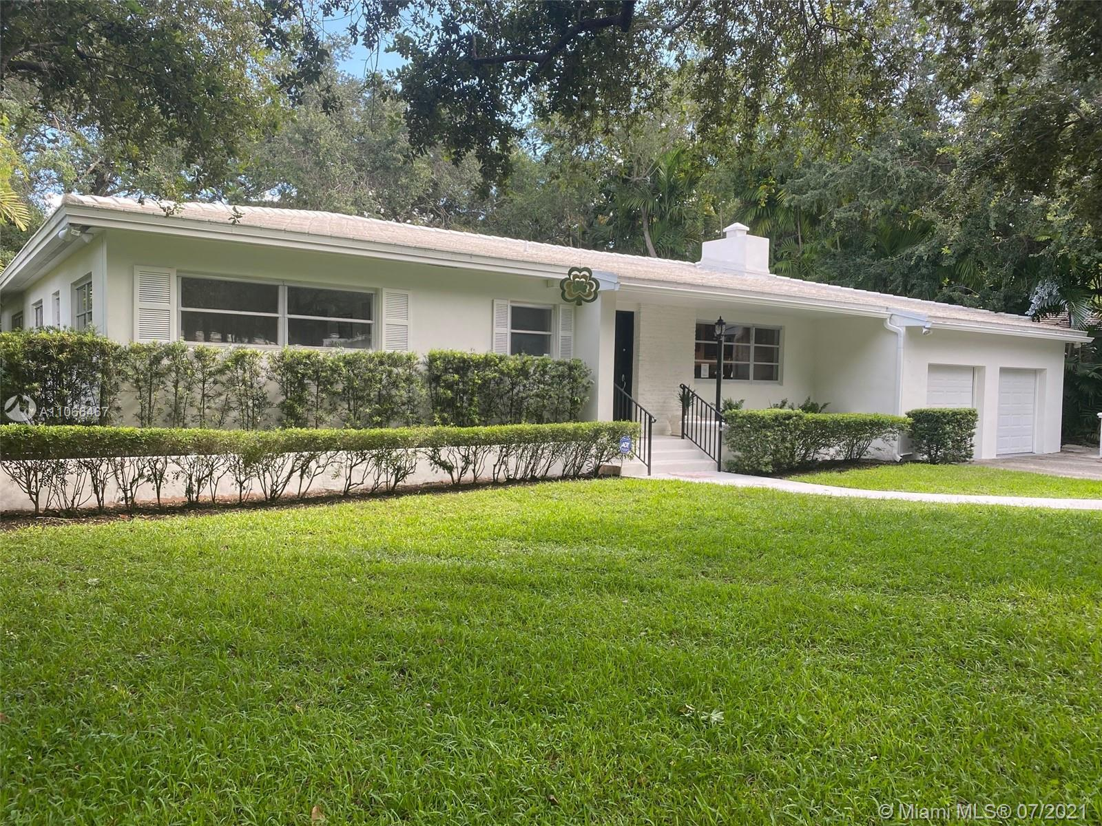 Incredible rare opportunity for this mid-century home located in the highly sought after Platinum Triangle in centrally located South Coral Gables surrounded by multi-million dollar homes.  This exquisite property sits on a 13,770 sq ft lot with a large backyard, and lush mature landscape with tropical trees on an oak tree canopied, quiet street.  Charming integration of its indoor and outdoor elements, and expansive open spaces.  Current  floor plan entails spacious rooms, Miami-Dade hardwood pine floors, walk-in closets, oversized 2 car garage with lots of storage.  Update, add-on, build up or create your dream home.  Located close to excellent public (Sunset school district) and private schools, and a short distance to great restaurants, hospitals, supermarkets, shops, and much more.