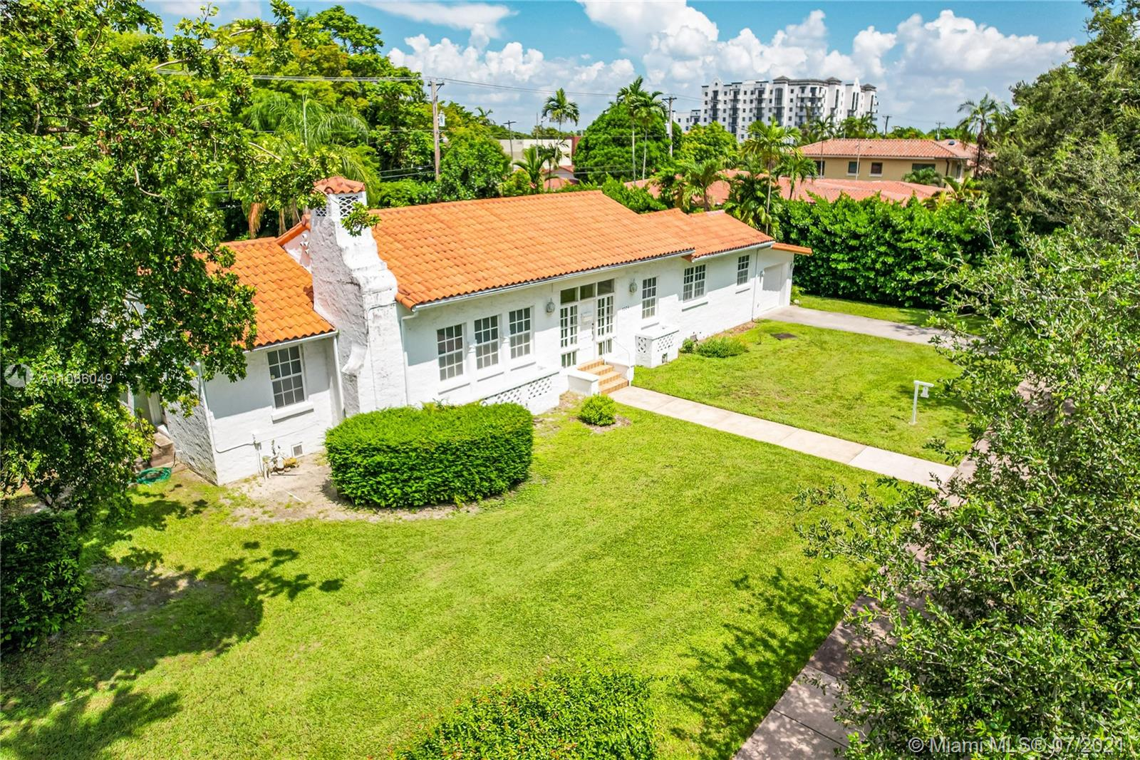 An original 1923 Mediterranean Revival historic home, commissioned by George Merrick, and designed by renowned architect Elliot Kiehnel. It sits on nearly an acre of land. The home features 3 bedrooms, 2.5 bathrooms, and a spacious living room overlooking the beautiful yard. A separate studio space offers lots of potential for an in-law suite, studio, or guest-house. Some historic features include the coral wall along 57th avenue, the stone walk-way and the outdoor coral fire-pit, and several coral structures. There are abundant trees and foliage including avocado, tamarind, mango, star fruit, egg fruit (canistel), and a Chinaberry tree. This home is a diamond in the rough, just waiting to be restored to your liking.