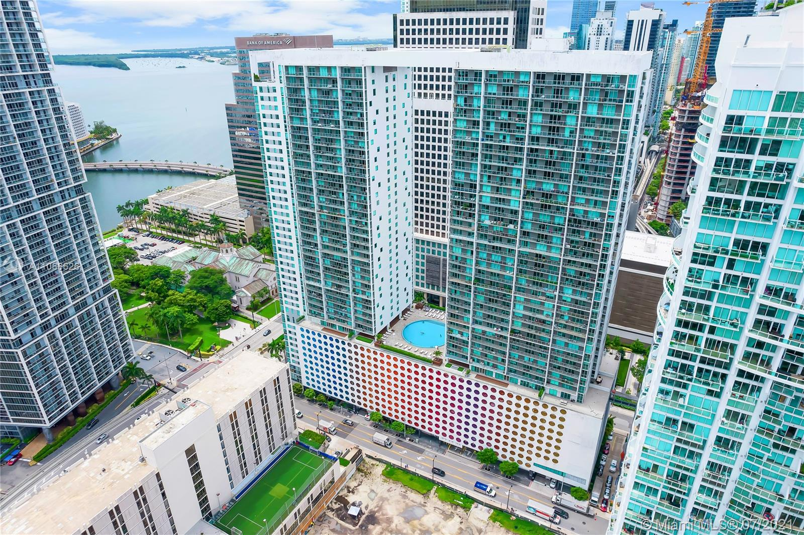 Great 2 bed/2 bath north-facing unit in the heart of Miami's desirable Brickell district. The unit has fantastic views of Biscayne Bay, Miami River, and downtown Miami, ceramic floors throughout, master bath spa, roller shades, and blackout treatment. Close proximity to all the things Brickell has to offer: restaurants, shops, grocery stores,public transportation, and Brickell City Centre. Building amenities include the main deck pool, fitness center, private theater, clubhouse with pool table and TV screens, and best of all, a spectacular rooftop pool deck featuring breathtaking views of the Miami Skyline and Biscayne Bay. 24/7 lobby security guards, CCTV and valet. 1 designated parking spot. Showings by appointment only. Equal Housing Opportunity.