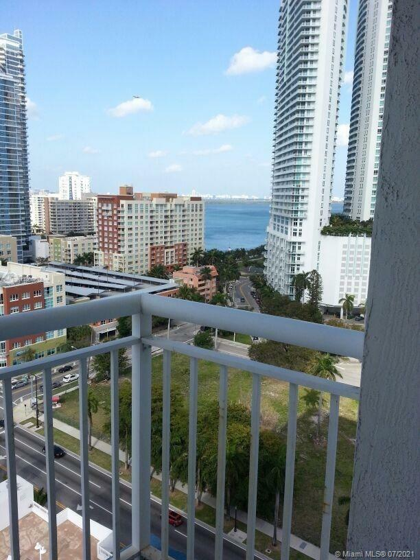 Laminated high quality waterproof floors! Best 1 bed line, Excellent Location, beautiful north vistas, and bay views from balcony, bright unit in the heart of Edgewater, wash and dryer inside the unit, granite counter tops, open kitchen, carpet floors, walking distance to Bayside and American Airlines Arena, 1 Parking Space, Pool, Gym, social room. 24 hours Doorman. Publix cross St. Only with appointment 24HR notice.  No dogs, other ok. Only 1 Yr lease