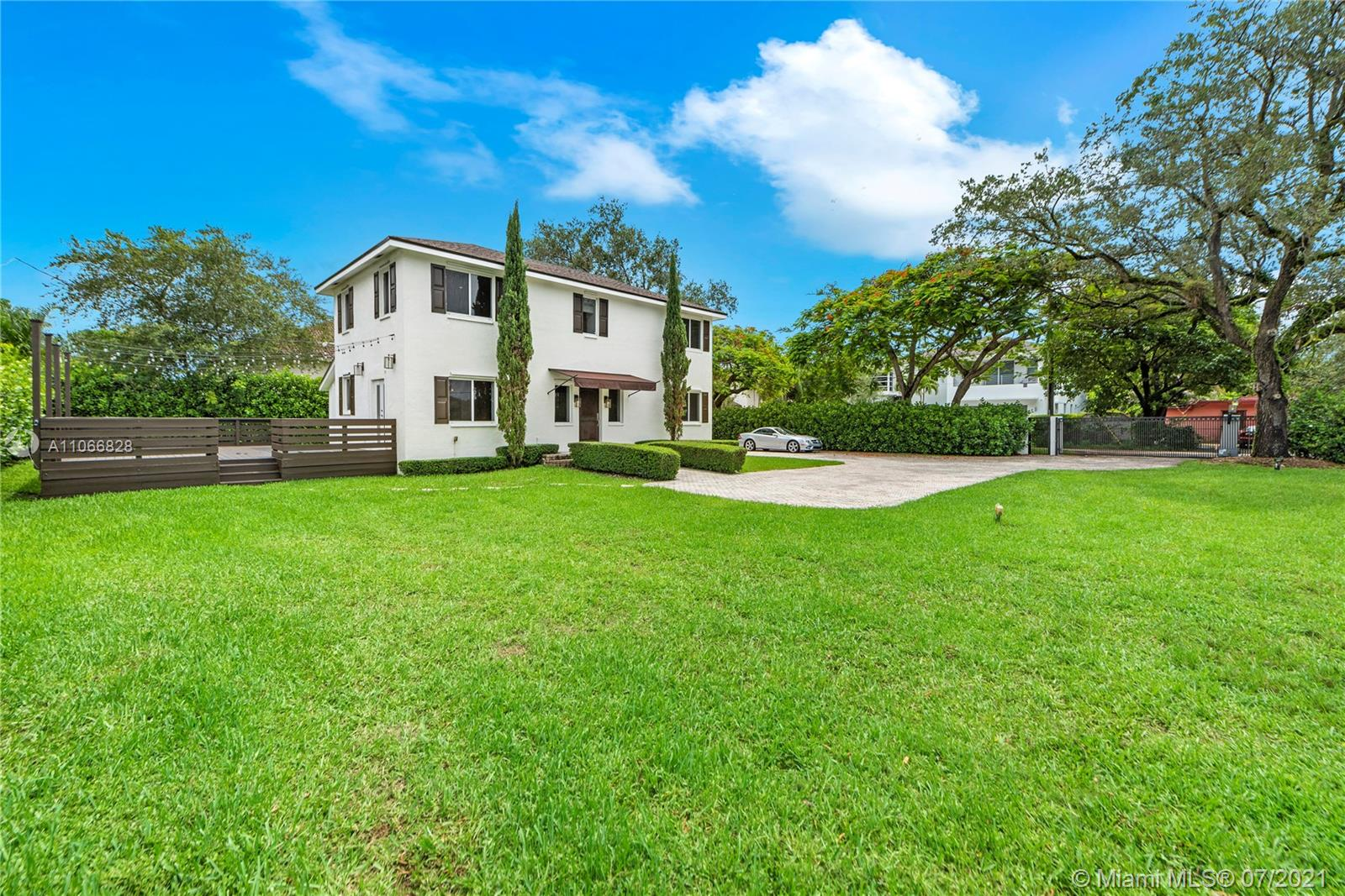 A beautiful remodeled estate with 16,240 square feet of land, centrally located near South Miami Hospital, restaurants, US1, and Sunset. One bedroom/ One bath downstairs and Three bedrooms/One bath upstairs. Beautiful custom finishes throughout the property. Updated kitchen, baths, floor, and custom closets. Long pavered driveway with enough space to put a pool, build a new property, and put an addition to the current property. No HOA. Ready to move in.