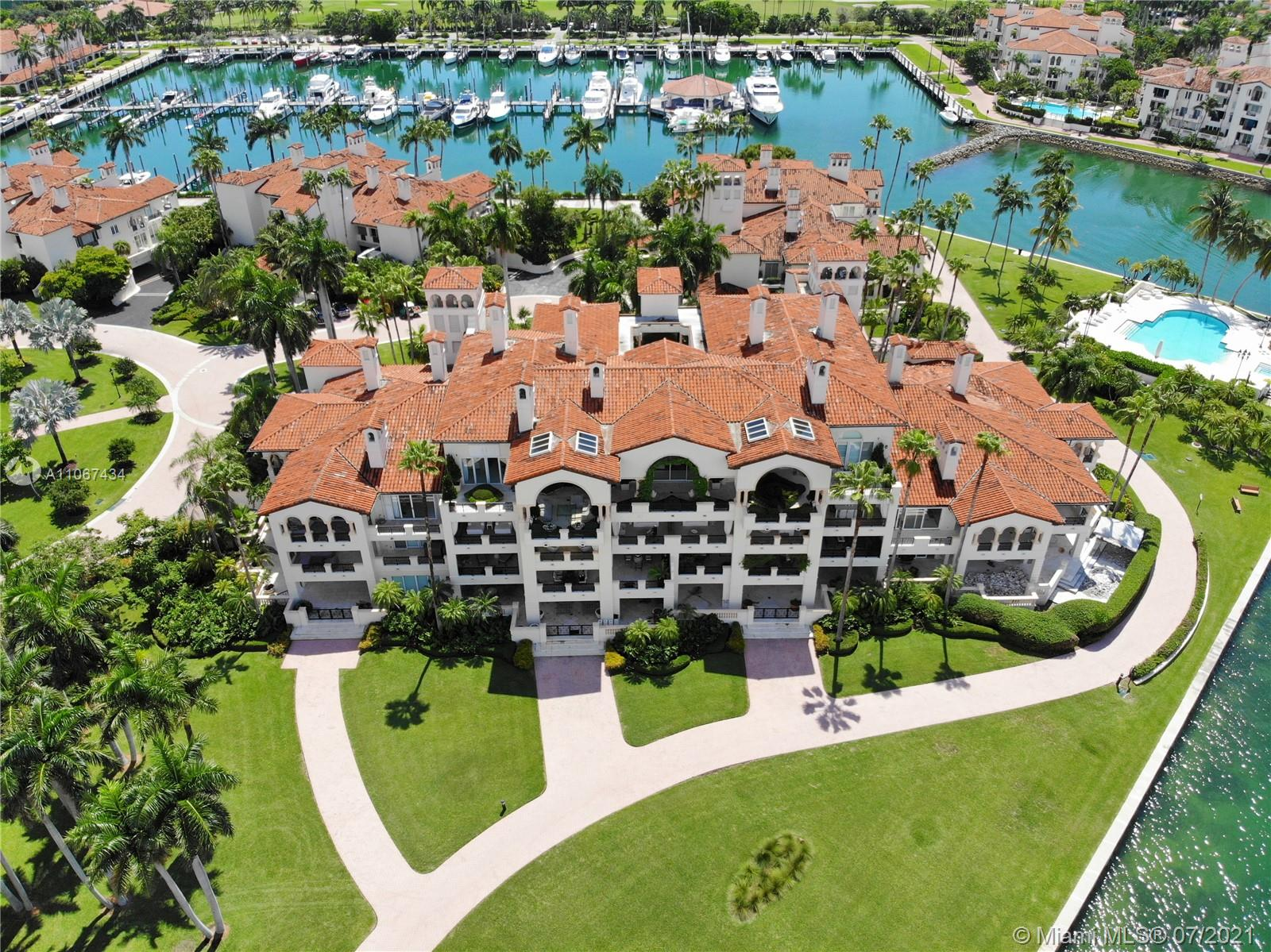 Experience Fisher Island at it's finest. Amazing double unit that was combined into a single stunning unit that encompasses the whole third floor. It has 5 bedrooms, 6 bathrooms, powder room, a movie theater and a staff quarters complete with a staff bathroom. Stunning views from this magnificent unit located in one of the most sought off buildings in Fisher Island. Enjoy breathtaking views of the ocean and the downtown Miami skyline. Amazing balcony with over 3,000 sqft of direct ocean view. Unit comes with 4 parking spots.