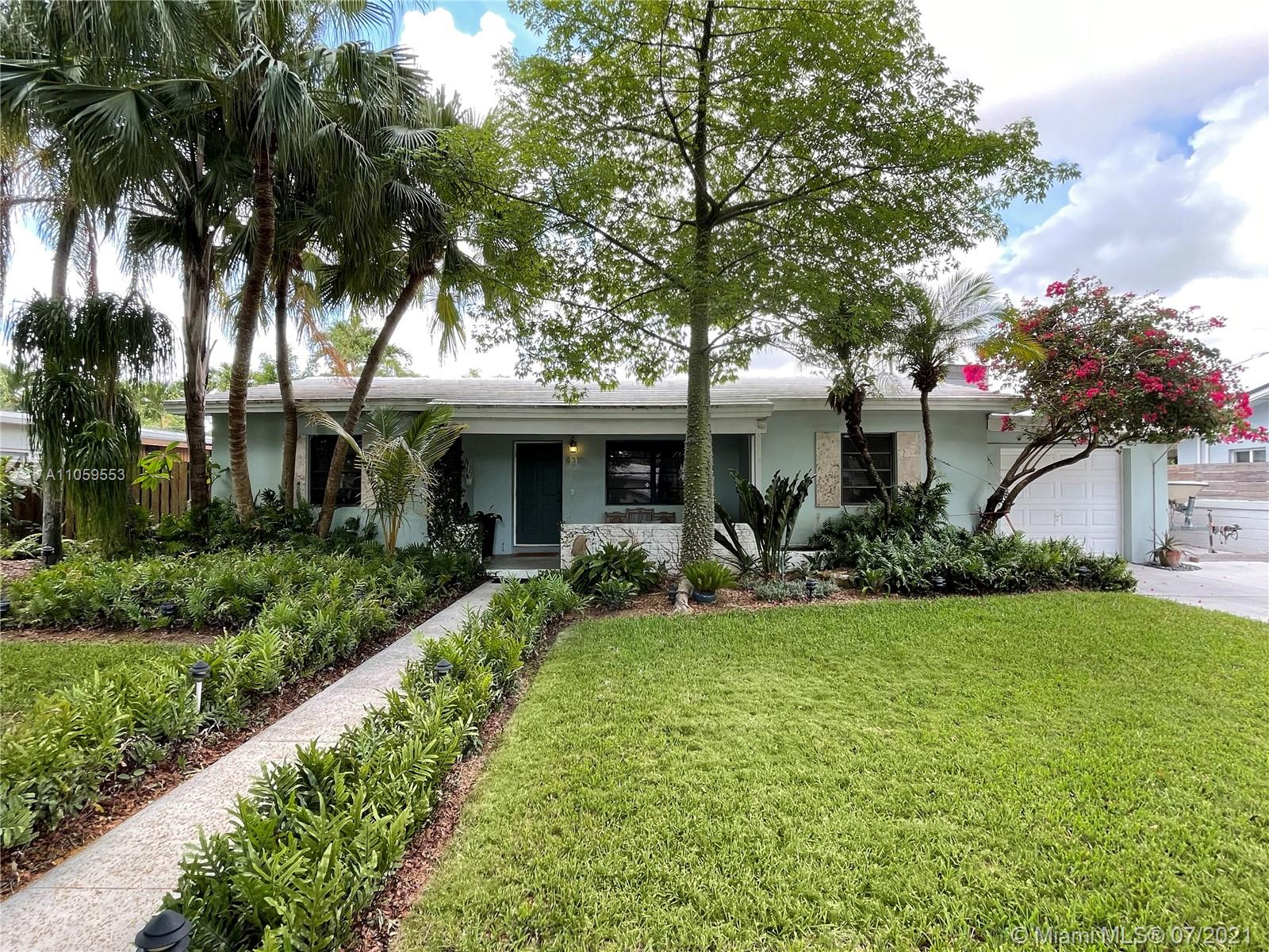 Gorgeous split plan 3/2 with spectacular outdoor living spaces. Located adjacent to South Miami and Coral Gables near best public and private schools, UM, shopping, restaurants, night life, parks, transportation and hospitals. Neighborhood is private, secluded and friendly. Sidewalks and large shade trees. Wood floors over terrazzo, High ceilings, Gas range, Electric oven, Florida room, Beautiful large pool, Stone pool deck, Natural wood elevated deck, Outside bar. Magnificent, lush landscaping with mature native trees and flowering plants.  Side yards have paved small boat storage and elevated kayak storage. Move in tomorrow and enjoy or add your personal touches. This home has a wonderful energy that will fit your Florida lifestyle. It is a special opportunity that will not last.
