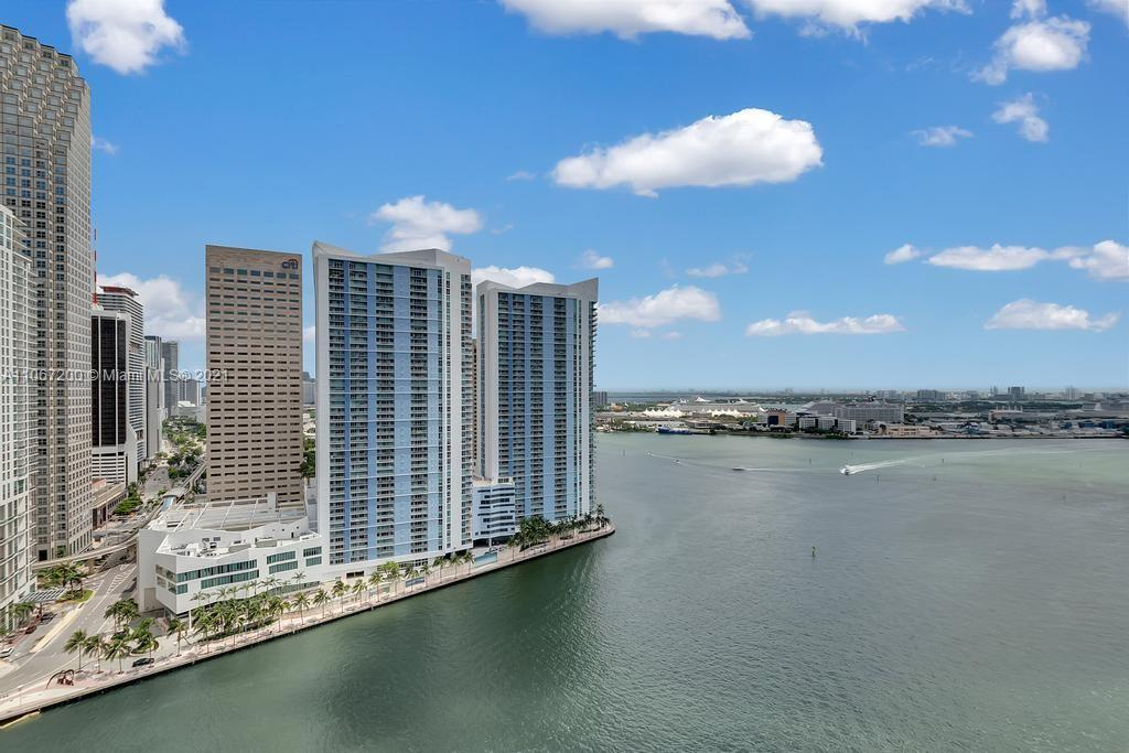 Dominating water and Skyline Views from this corner residence in the acclaimed Carbonell Condominium in Brickell Key.  Four full in suite bedrooms, laundry room, marble floors, chefs style eat in kitchen, marble bathrooms, california closets and wrap around balcony are just the beginning to describe this residence.  Two assigned parking spaces included.  Don't miss the opportunity to own one of the limited residences in this full service building.