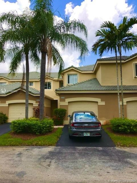 Amazing opportunity to own a 3/2.5 Townhouse in gated community in SAN MATEO. Screened in covered paved patio - attached garage - No neighbors at the back, pool garden view -  Tile flooring downstairs - 3 year old A/C -  Best Schools in Weston !