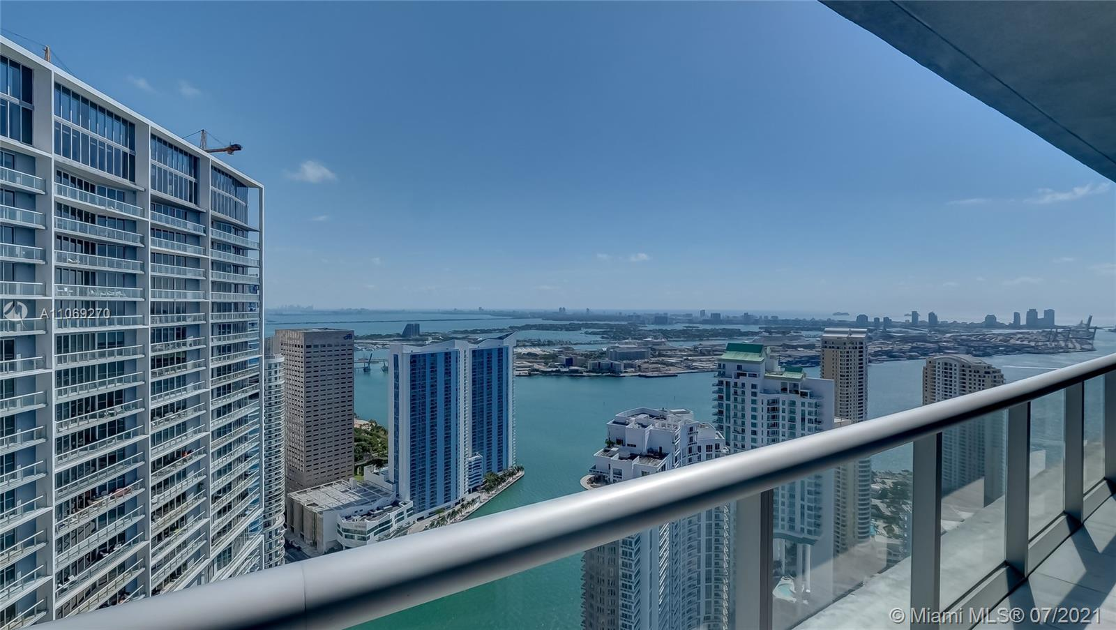 Luxury condo on the 54th floor boasting beautiful, capivating views of the skyline and ocean bay while centrally located in the heart of Brickell. Unit offers a bright and welcoming ambiance, 2bed - 2bath, Marble floors, top of the line appliances, in-unit W&D, ample closet space, soak tup in master room with standup shower,  open living space with den/office and many great details. The building is fully loaded with amenities; A charming, luxurious spa, top of the line gym, iconic - olympic size pool, restaurants, and a short walking distance or scooter ride to surrounding activites, restaurants, Whole Foods, shopping and Miami night life.
