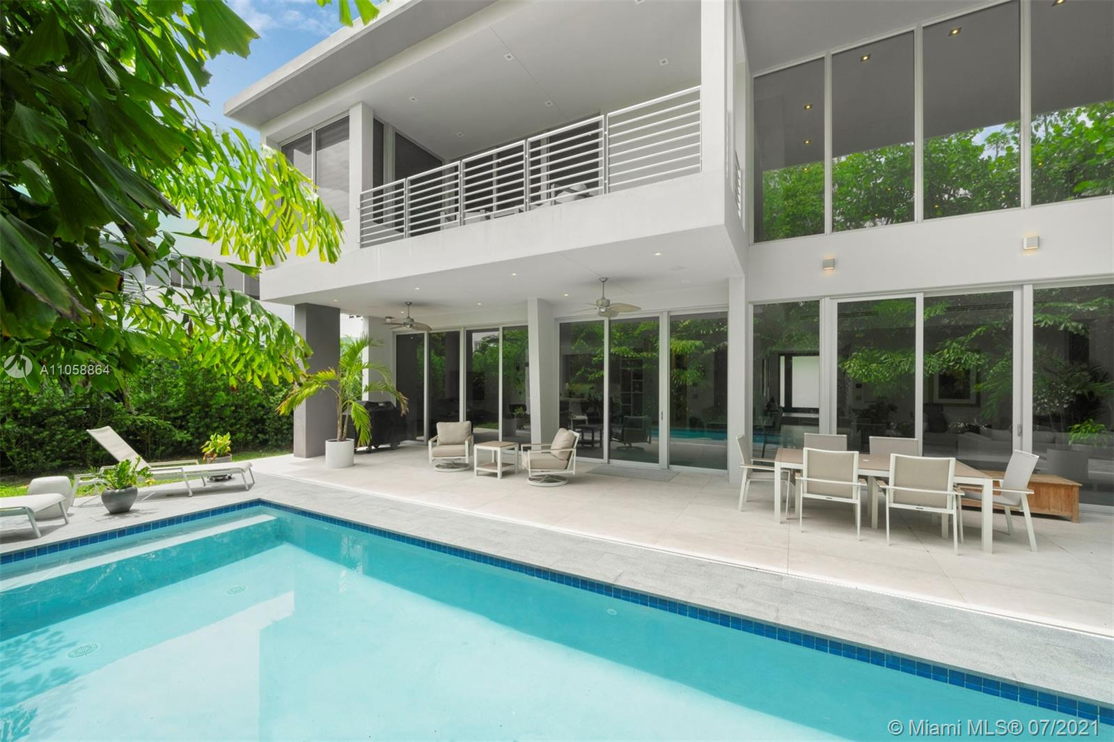 This modern and contemporary 6 BR, 6.5 BA home in Ponce Davis has 6,734 Total Sq.Ft. and spectacular light-filled living spaces. The entrance foyer reveals a spacious open floor plan with double-height floor-to-ceiling windows. The living, dining, family and kitchen areas open to a resort-style backyard, sparkling pool, and covered terrace ideal for outdoor dining. The kitchen comes with marble countertops, an island with seating, Wolf appliances, and a Sub-Zero refrigerator with custom panels. Surrounded by balconies and lush landscaping, there are 4 ensuite BR upstairs, including the main suite with a lavish bathroom and custom walk-in closet. Additional features include a pantry and a 2-car garage. Minutes from schools, restaurants, shops and entertainment. *Tenant occupied until 12/26.