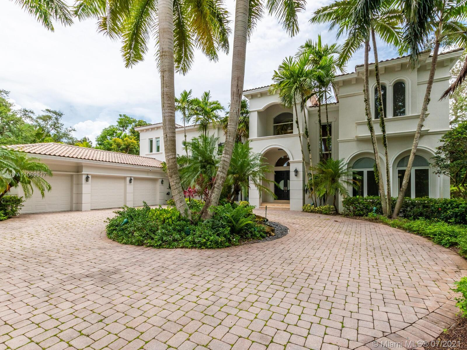 One-Acre Supreme Luxury Estate in NE Pinecrest. Striking & tropical, this extraordinary residence w/seemingly more windows than walls comes to market after a complete 2021 remodel. Drive thru the gates over Chicago pavers into a lush palm grove, then pass thru exterior & interior foyers to enter a grand space of volume ceilings, a sky-high wood façade & staircase + sunlight pouring in from all sides. The spectacular new kitchen has Sub-Zero, Thermador & Dacor appliances, along w/a cooking island, butler's pantry & wine fridge. Speaking of wine, there's a 700-bottle wine cellar! The all-new baths have marble tile; the bedroom flooring is chic wood-look porcelain. The huge pool patio & yard serve as playground, sanctuary & entertainment zone. Staff qtrs, service stairs, 3CG, impact wdws/drs.