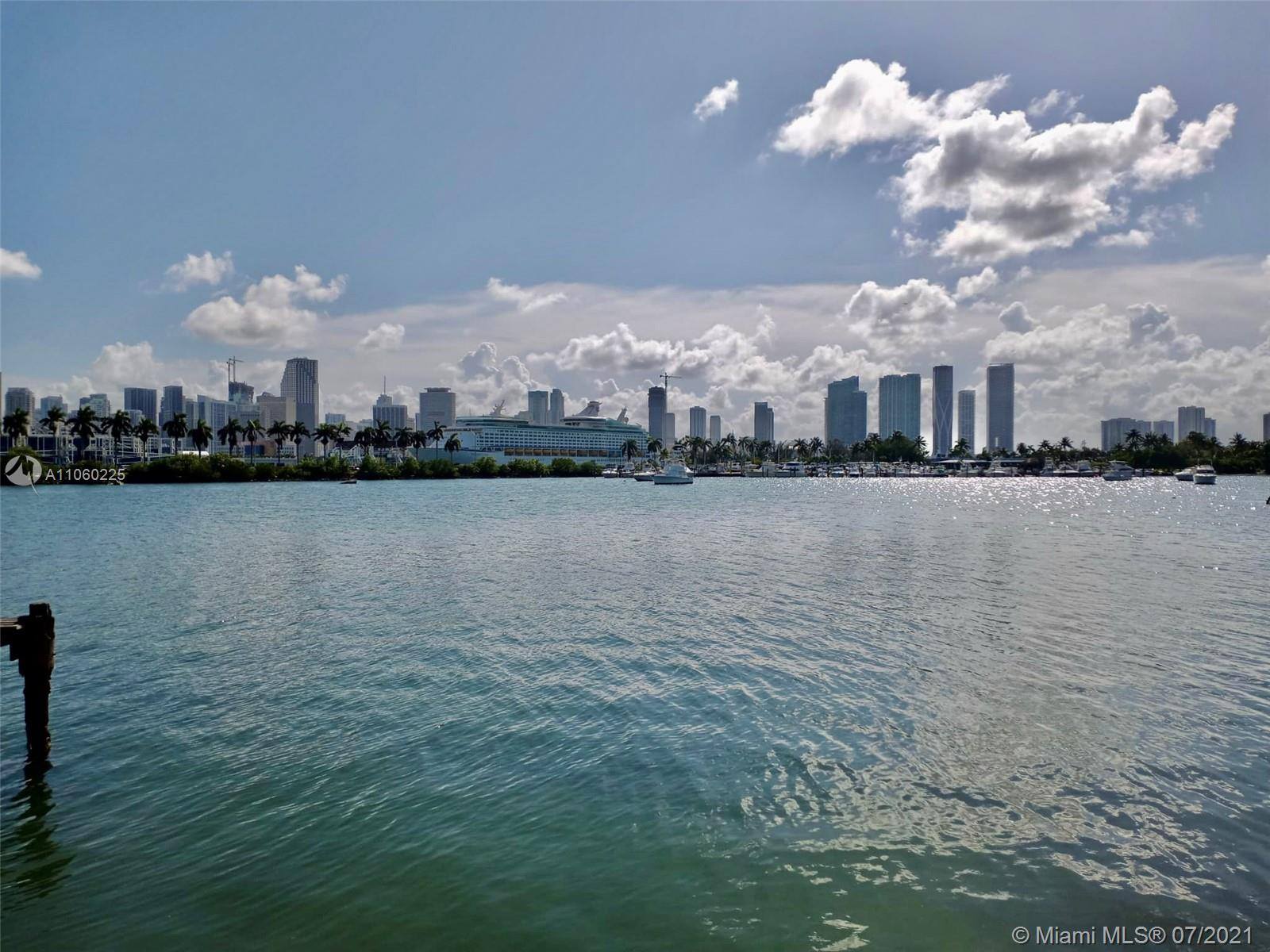 First time on the market in 30 years ! Exceptional opportunity ! Unique property in V shape with more than 80 ' on the water facing directly downtown Miami . Remodel existing house or build the house of your dream Will not last!