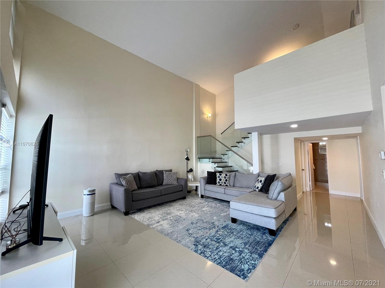 Immaculate, completely upgraded, modern townhome in the heart of Aventura, w/ breathtaking views of the intercostal waterway & skyline. The home features a new roof (2019), soaring 18 ft cathedral ceiling, double master suites upstairs, den downstairs large enough to be a third master bedroom, loft, modern glass stair rails, high polished imported porcelain tiles. Big upgraded kitchen, w/ double pantry, real wood cabinets, granite counters, glass black splash & stainless steel appliances. All bathrooms upgraded. Master bath features an oversize jacuzzi tub & separate water closet. Enclosed patio perfect for entertaining & BBQing. Property amenities include, pools, gazebos, tennis courts, gym, sauna, & billiards room. Water, Sewer, Trash, Internet, & Cable included w/ HOA Fees.