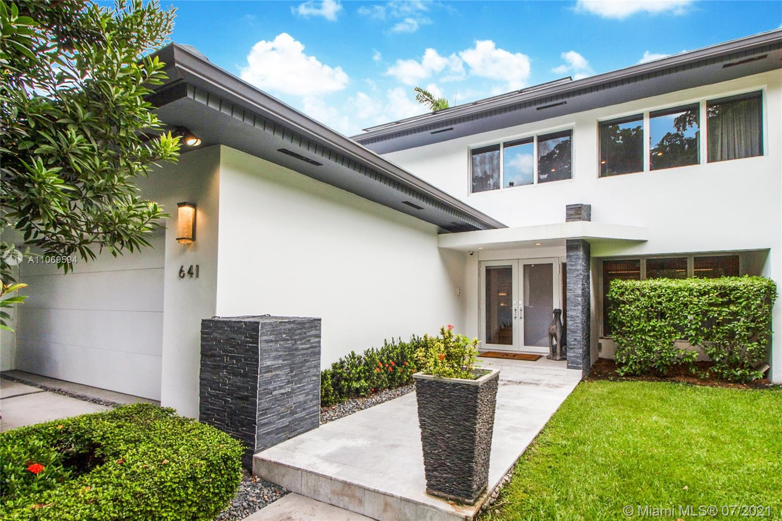 Lovely Sevilla. Just minutes from Downtown Coral Gables, this two-story 3/3.5 fully renovated in 2016 features a light and bright open floor plan, impact windows/doors, bonus office/den, marble & wood floors, oversized laundry room, a true 2-car garage, 9.1 kW solar panel array, electric vehicle charger, beautiful private backyard with saltwater pool and built-in BBQ. Curb appeal galore at an outstanding address.