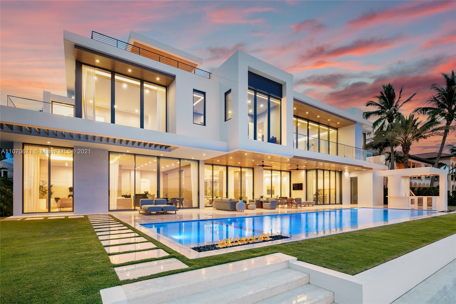 This stunning modern masterpiece boasts 6 beds, 7 full baths & 2 half baths in the highly sought after Harbor Beach gated community. This residence was designed by Randall Stofft & built to perfection by Sarkela Corp. Equipped to dock a mega yacht, this home features vast Intracoastal views that seem too good to be true with 120 ft of water frontage, a lap pool & full summer kitchen. No detail was missed with generous entertaining spaces both indoor and out, 2 master baths, DuChateau oak floors, 200 bottle wine cellar, 2-story marble fireplace, imported custom furniture + artwork, Terzani chandeliers, Italian cabinetry, Dornbracht bath fixtures, Crestron smart home system, separate prep kitchen, lounge/bar area, & full home generator creating your own resort style single family dream home.