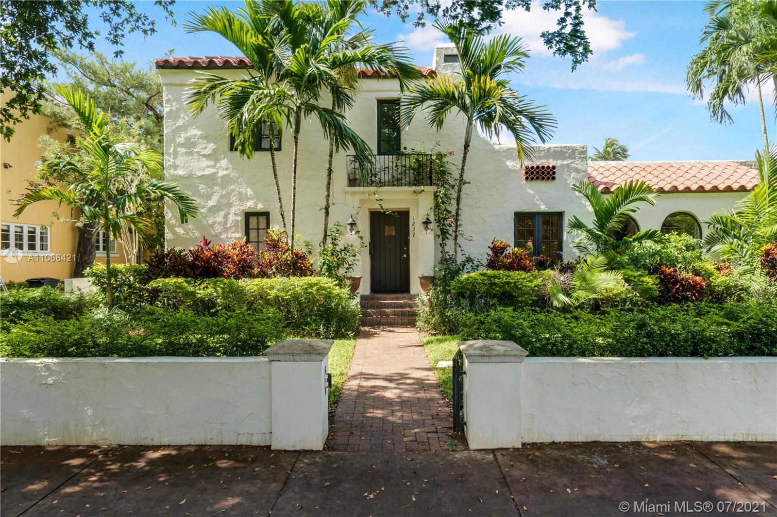 Exquisite elegance and charm define this renovated old Spanish house sitting on an almost 13,000 SF lot with tons of curb appeal and a beautiful back yard to enjoy Miami's lifestyle! Split floor plan with 4bedrooms / 3 bathrooms on one side of the house and another second master suite or large family room/guest suite on the other side of the house.  All bedrooms have plenty of closet space and extra living spaces, perfect for today's lifestyle with the rise of the home office. Hardwood floors throughout most of the house, gas stove, fireplace, impact windows with beautiful views onto a stone patio and gorgeous pool area.  Kitchen and bathrooms were recently updated. Great location next to the best tennis in Miami, the Biltmore, the Golf course, the Venetian pool and top rated schools.
