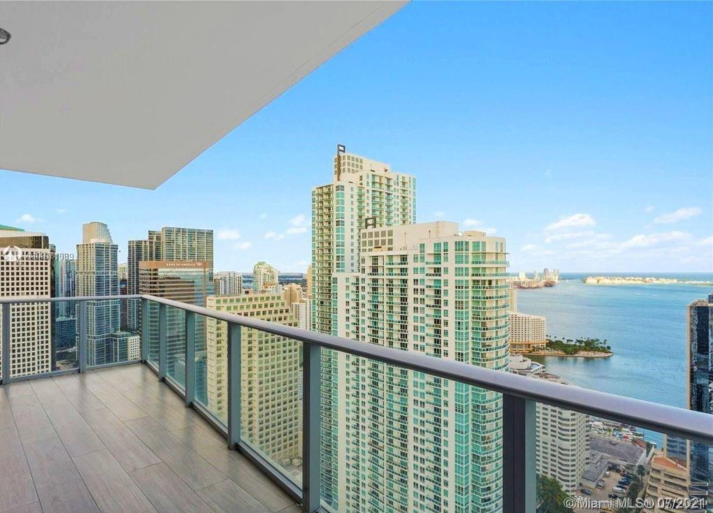 High floor and spacious corner unit, with 3B plus Den and private elevator. with 180 degrees of amazing views to Brickell & Downtown skylines. The  balcony is ample and comes with  bbq/summer kitchen. Most spectacular amenities 2 complete floors of entertainment, Indoor heated pool with retractable glass, parent/child pairing wristband system, state of the art gym & spa with steam baths, basketball & squash courts, jogging tracks, bowling & mini golf/simulator, game room, playground, movie theater, business & social rooms, valet, roof top & sun deck with views to die for, bar, pool & jacuzzi.