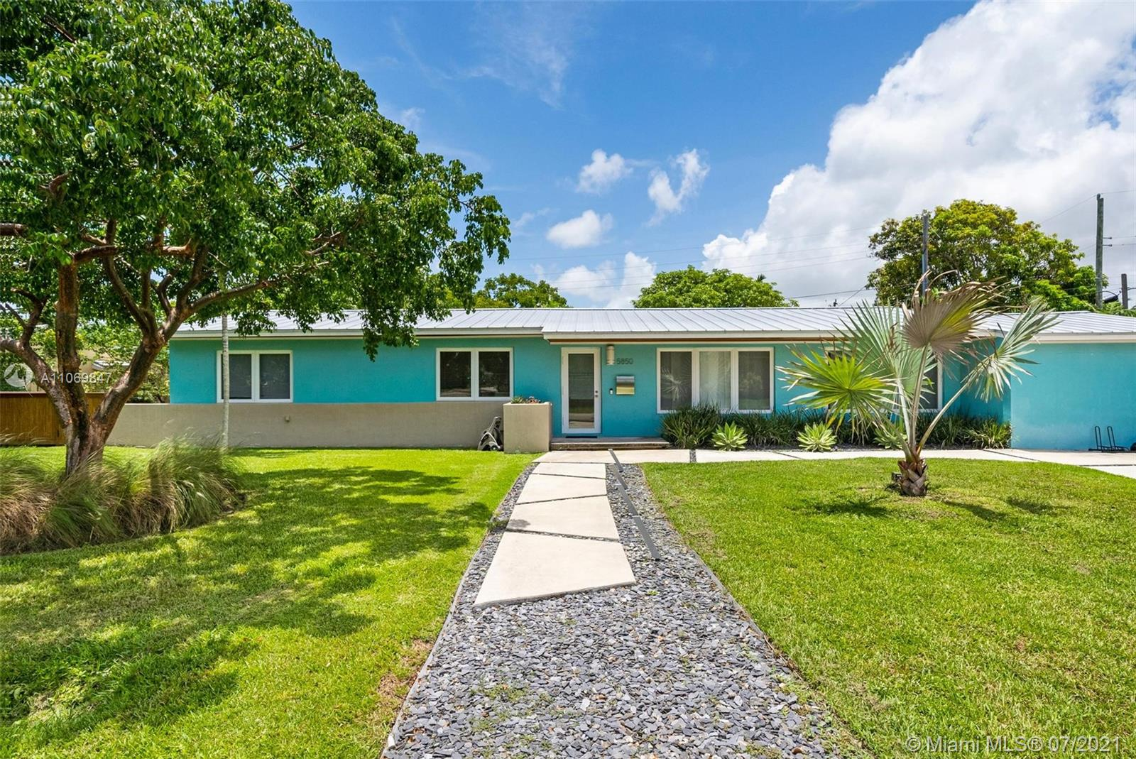 This move-in ready, mid-century home is tastefully updated while respecting the beauty of its original architecture. Plenty of space to entertain, inside & out. The bright home features impact windows & doors that let in natural light, highlighting original, refinished terrazzo floors as well as a remodeled kitchen & bathrooms. On this expansive 12,199 sq ft lot also sits a heated pool & detached wood pergola, flanked by a bamboo fence on all sides for privacy. Garage was recently converted to include AC (mini split), added storage & laundry area; perfect for an in-home office, guest room or gym. Added bonus; gas line which is currently connected to gas water heater. Just a short walk from Brewer Park & near the University of Miami, Baptist Health South Miami Hospital, shops & restaurants.