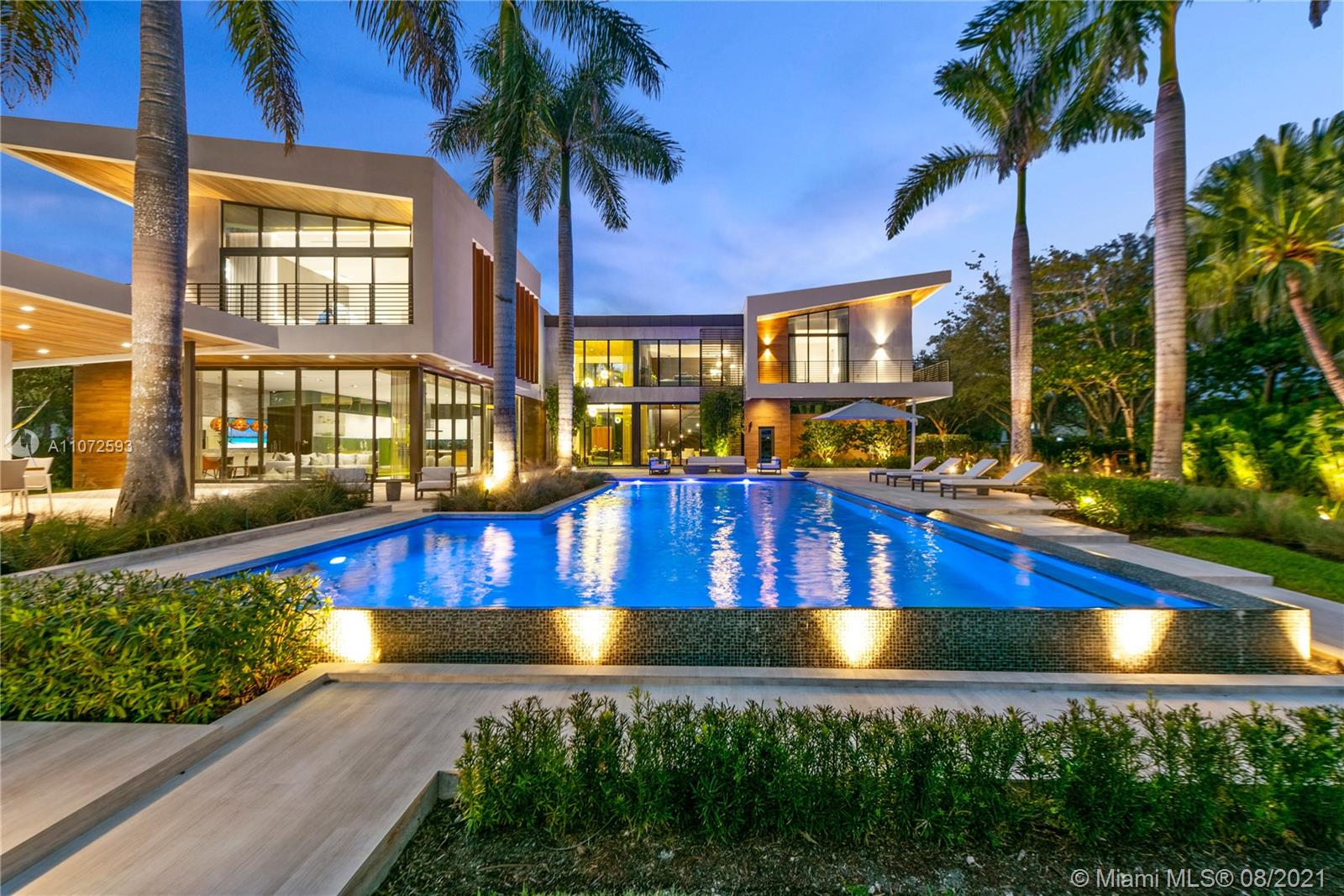 """A one of kind NEW MODERN MASTERPIECE that has been developed with incredible detail that exemplifies the true meaning of luxury. Situated in the most exclusive gated communities in Weston, on a 1.60 acre lot, this unique home overlooks a spectacular long open lake view. The state of the art features: HD security cameras with commercial grade system (13 cameras) direct access from home, phone, &computer. Smart home with 2 APPL ipads/lutron syst controlling all lights, surround system throughout home/pool & cameras, accessible from anywhere in the world. Full house generator & top of the line appliances w/ a Butler's pantry..list goes on.The """"resort"""" feel & architect of this home is one to see. An opportunity to own a piece of art in Weston has arrived. Furnished. Features sheet attached."""