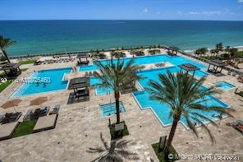 Beautiful NE corner unit in Beach Club Tower Three with direct ocean view overlooking the pools plus city view. Unit interior has tasteful upgrades, professionally decorated.  2 bedrooms and a den, 3 ½ bathrooms, 2,078 sq. ft. living area plus wrap around balcony, floor to ceiling impact windows, marble floor and European style kitchen. Building has 24/7 concierge and valet services, and a private gym for residents of this tower. Beach Club amenities feature a 50,000 sq. ft. fitness center with Spa, restaurant/bar on 7th floor pool level, and offers beach service. Artwork not included in sales price.