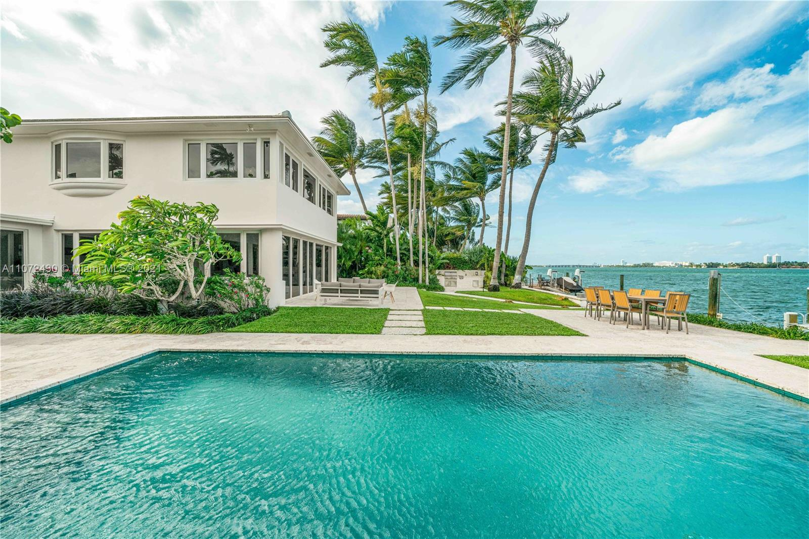 Mid Century Modern Home on the prestigious Venetian Islands. This timeless masterpiece was renovated by the renowned real estate developer Todd Michael Glaser in 2020. A rare find, this gem is located on an oversized Lot with 90' of water frontage. Northeast Views & an incredible ocean breeze accompany this remarkable residence. Private dock can accommodate an 80' boat. Please allow 24-hour notice for showings.