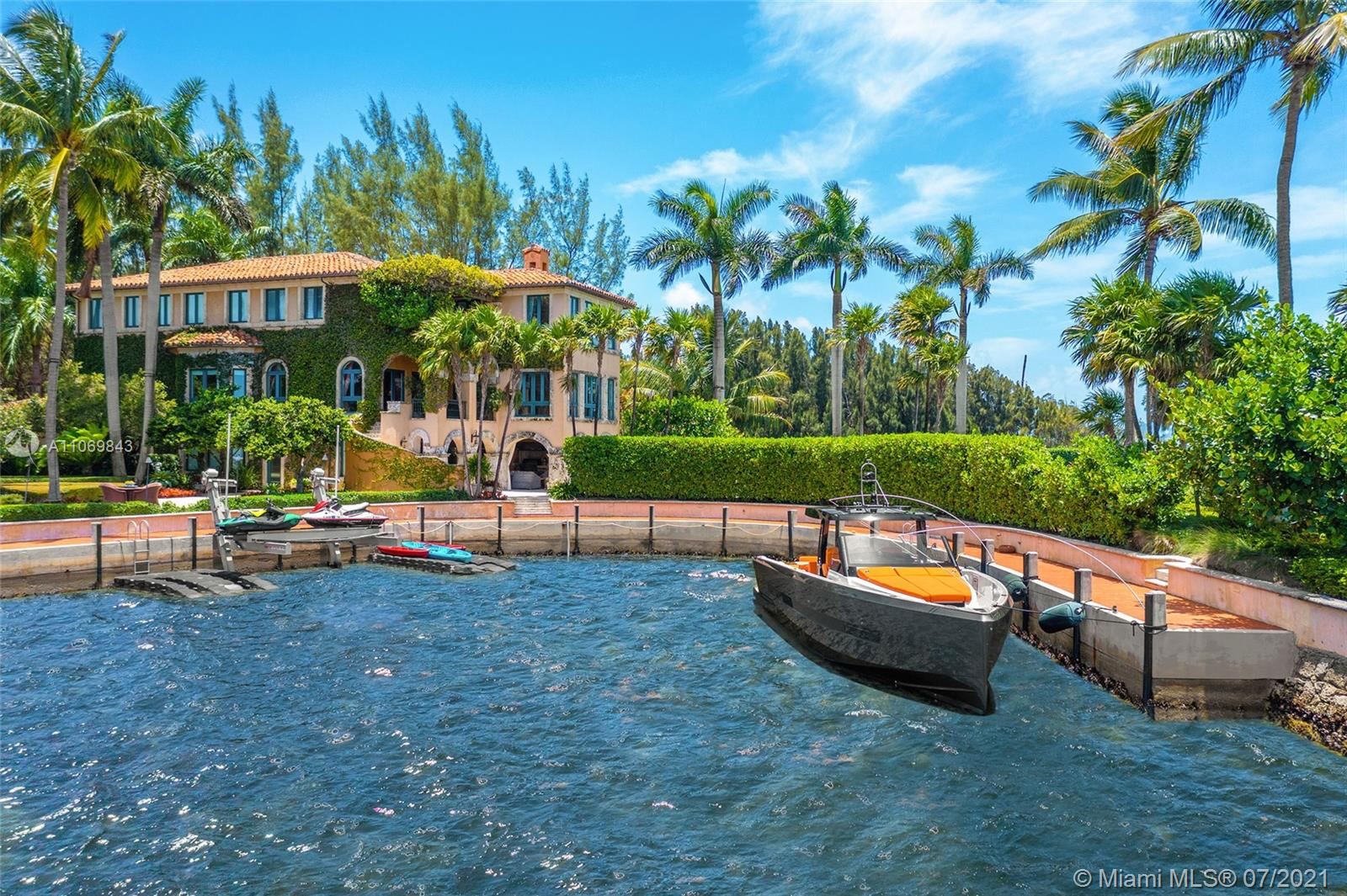 Welcome to Villa Cristina, world class waterfront estate delivers utmost privacy w/ approx. 1 acre of surrounding beauty & 482' of WF that both awes & inspires. Enter through a private, cul de sac gated entrance framed by arching trees concealing a private sculpture garden & grounds that will take your breath away. Tucked within the prestigious guard-gated enclave of Hughes Cove, this compound exudes seclusion, sophistication & elegance. Encompassing 3 stories, the estate features views from every room, elevator, formal dining room, service quarters, gym, gourmet kitchen & office. Outdoors an infinity pool neighbors a magical pathway leading to a spa, private lounge overlooking the endless ocean vistas & a private cove w/ a dock. This Venetian style palazzo estate is in a class of its own.