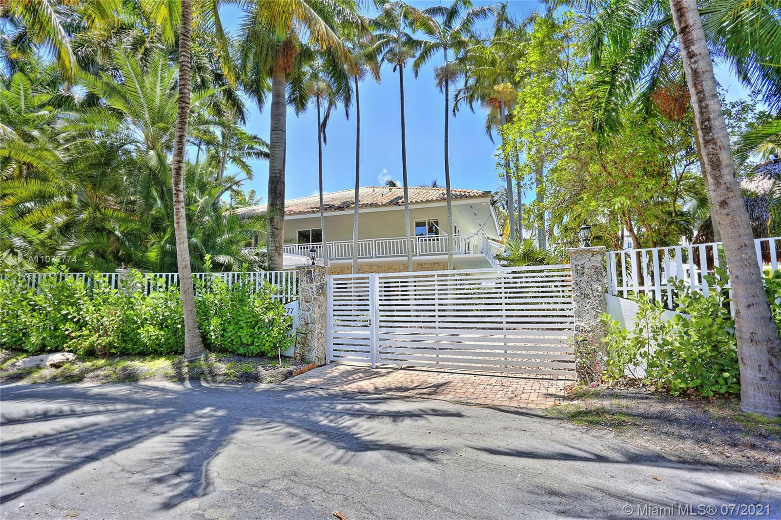 This stunning + remodeled, modern Key West-style home sits on a 19,500-square-foot waterfront lot in Coconut Grove's private + gated community, Entrada Estates. This spectacular home features 5 bedrooms each with en-suite bathroom + private balcony, a 1,000-sq-ft master suite, a fabulous open floor plan, exquisite gourmet kitchen, 2nd floor family room, covered parking for 5 cars + a tropical pool. The property has a 150-ft seawall + is only one house from Biscayne Bay + direct ocean access. The community offers tennis courts + 24-hour security. Walk to Coconut Grove restaurants, shops, great schools + more. Miami Dade Tax Rolls show 5,037 adjusted sq ft.