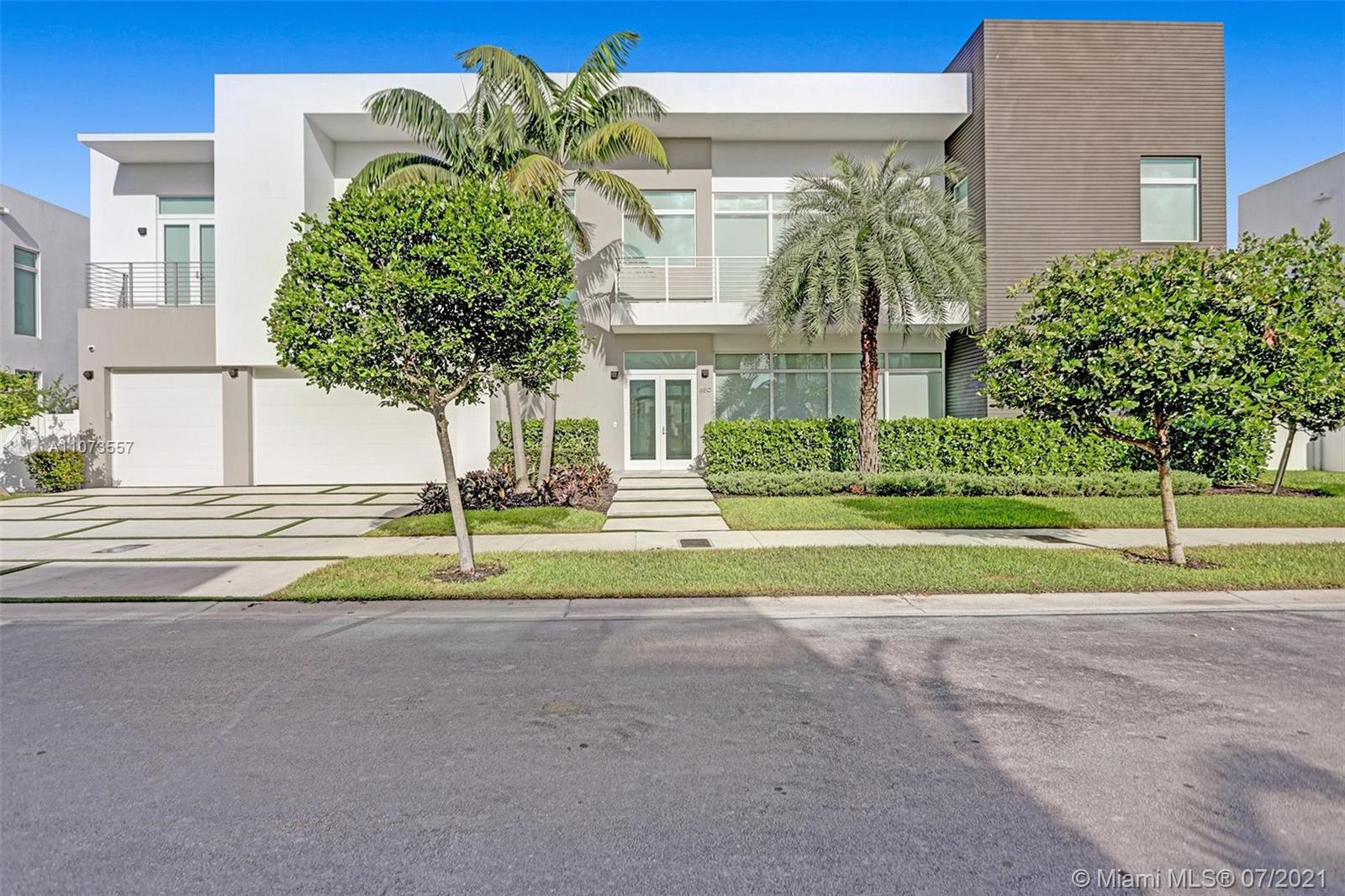 Stunning single family home in the most exclusive gated community in Doral, The Mansions. This property is the only available lake front with a doble lot. Beautiful 7 bedroom and 6,5 bathroom. With additional upgrdes, this smart home is fully automated including 14 cameras, sound system, media room screening wiring remote controlled lights & temperature , electric shades wiring 100% automatized smart home ipad controlled. Italian kitchen with top of the line appliances subzero & wolf. Impact windows. Guest house with full bath & 2 oversized roof terraces. Adjacent lake fornt outdoor BBQ kitchen overlooking the lake. 3 car garage , large driveway , lost of storage. Contemporary look and design. Only 56 luxurious homes in a gated community. Easy to show!