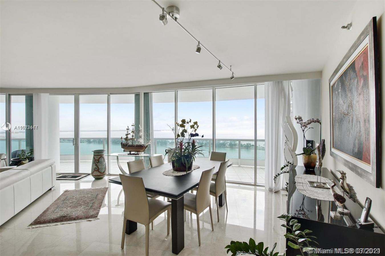 Enter through a private elevator to a spectacular 3 bedroom, 3 1/2 bath, 2,825 s/f home with hundreds of thousands of dollars of sophisticated improvements. Offering direct panoramic ocean and bay views. Enjoy the stunning sunset with Miami's everchanging Skyline from your wrap-around terrace of 880 s/f. Elegant interior, with custom design using the most beautiful Italian materials and craftsmanship, white marble floors, kitchen, bar, doors, bathroom, and his & her closets. The integrated kitchen features top-of-the-range appliances, with a large island for gatherings. Love its luxurious amenities with 24-hour security, gated entrance, tennis courts, 2 heated bayside pools, fitness center, spa, cafeteria, covered parking & valet. Price includes $10,000,000 in building improvements