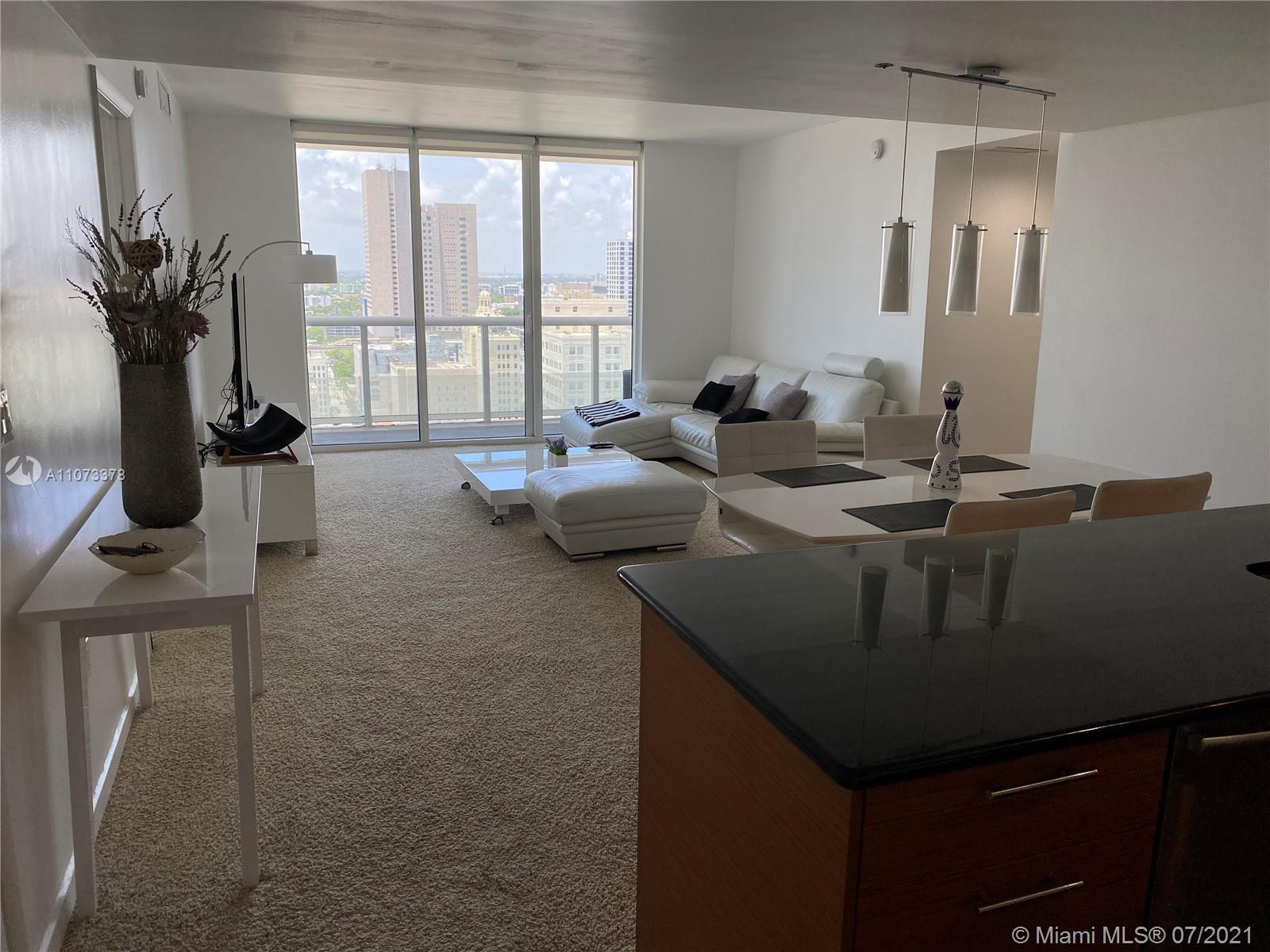 LOOKING FOR A MODERNLY DECORATED FURNISHED RENTAL? LOOK NO MORE! COME AND SEE THIS SPACIOUS CORNER UNIT WITH BREATHTAKING VIEWS OF THE SUNSET AND PARTIAL BAY. UNIT OFFERS A SPLIT PLAN LAYOUT, TILE FLOORS, CARPET IN BEDROOMS. S.S. APPLIANCES, GRANITE KITCHEN COUNTER TOP AND MORE. 50 BISCAYNE IS A FULL SERVICE BUILDING, LOCATED IN DOWNTOWN MIAMI ONLY STEPS AWAY FROM BAYSIDE, MIAMI ARENA, ART CENTER, MUSEUMS, DOWNTOWN GREAT SHOPPING AND RESTAURANTS. CLOSE TO METRO RAIL SYSTEM, A FEW MINUTES AWAY FROM MIAMI INTL. AIRPORT AND SOUTH BEACH.