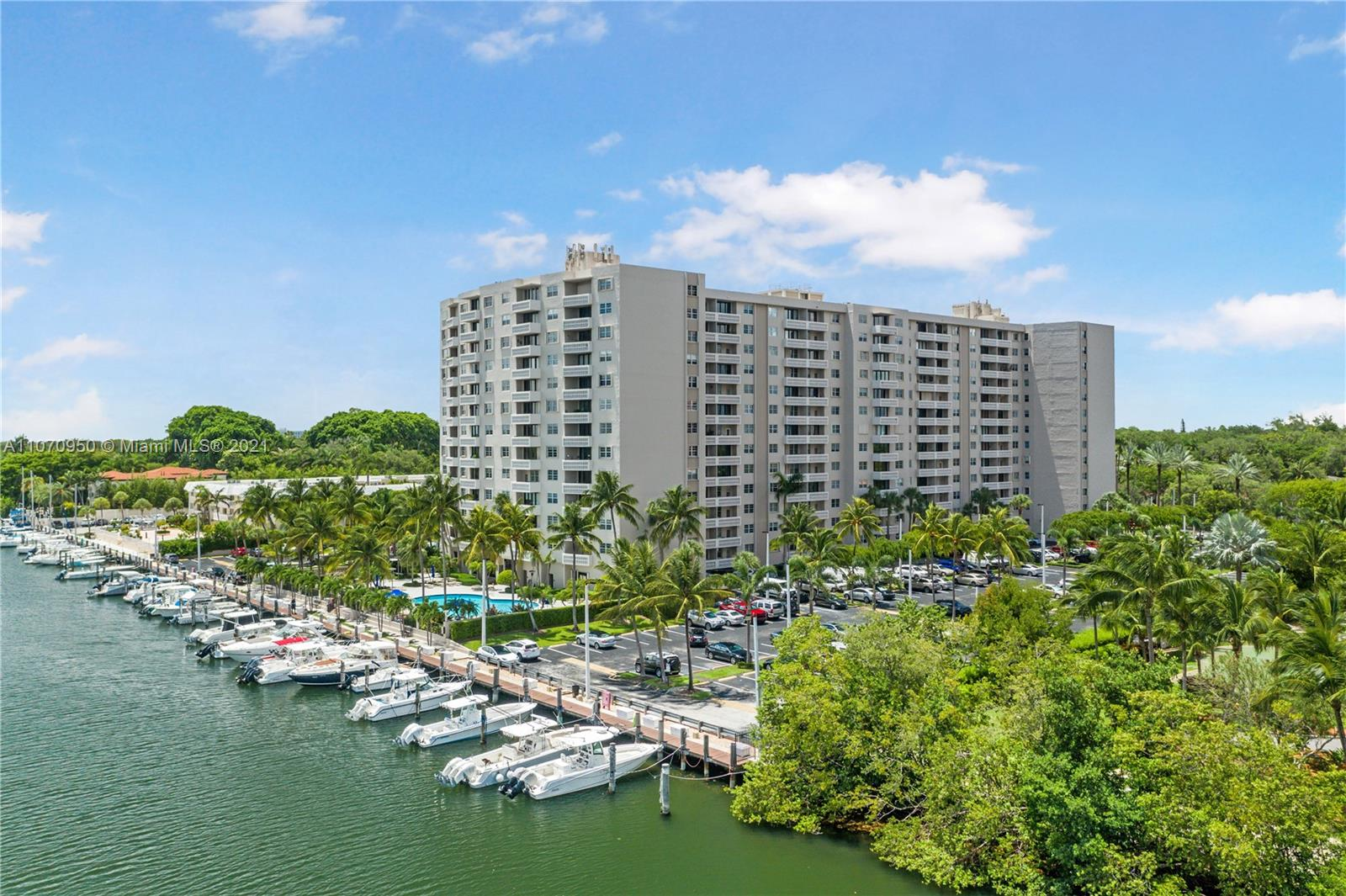 Gorgeous sunset views. A one-of-a-kind w/ custom woodwork throughout. Beautifully renovated w/ brand new porcelain floors throughout & full impact windows and doors. 1 assigned parking space + valet parking. Gables Waterway Towers provides 24/7 valet & security w/ doorman services. Amenities include Heated Pool, Gym, and Game/Party Rooms. HOA includes electricity for AC, Basic Cable, Water, and Building Insurance. Unit owners can add washer/dryer to their unit w/ proper permitting and approval. The building recently finished an $8.5M renovation and received their 40 & 50 year Miami Dade Recertification improvements for mechanical and safety code updates. Close proximity to the heart of Coconut Grove, UM, Downtown Coral Gables, and Airport.