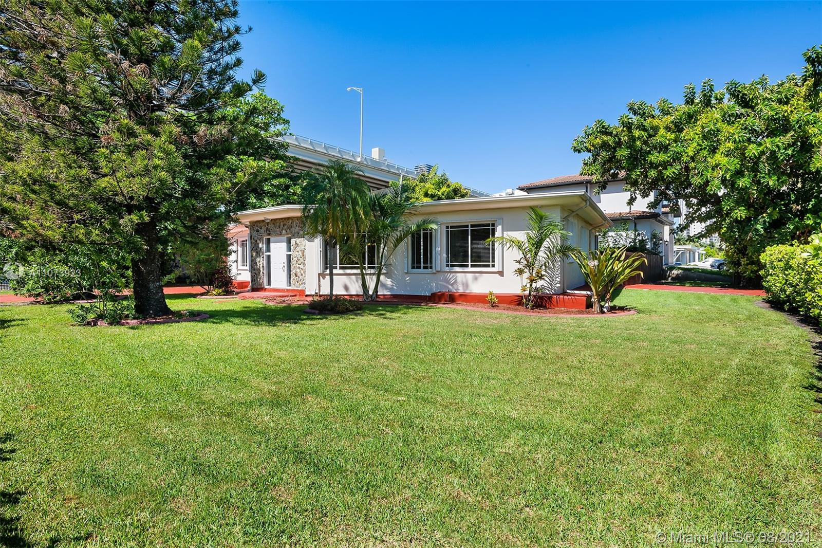 Great corner lot with 10,819 sq.ft. Larger than tax roll. Walking distance to the ocean.