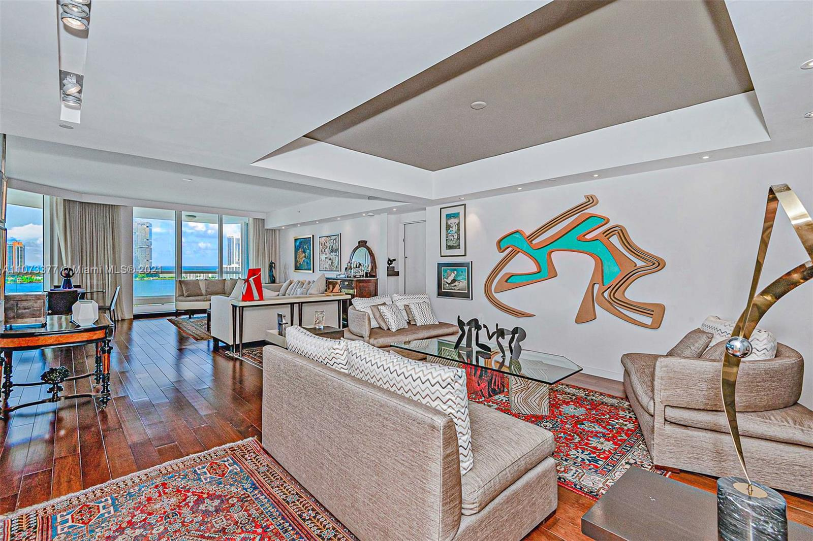 """A unique opportunity new to the market- rare 01 line!  Stunning 5 bed 5  1/2 bath residence with additional """"Studio Suite"""" included in the price on 4th floor.  Your private elevators, a foyer entrance. Custom-designed residence with, marble floors, and beautiful details throughout. Amazing views of the Intracoastal and ocean. Enjoy the lifestyle of Bella Mare and Williams Island, with 16 tennis courts, restaurants, a marina, a children's playground, spa, and dog park! This building features a private movie theater, fitness club, card room, juice bar, wine room a social room. One-time membership initiation fee of $7,500. Annual club membership fee of $1,750 as well as an annual food & beverage fee of $1,600+tax. Contact the listing agent for a showing!"""