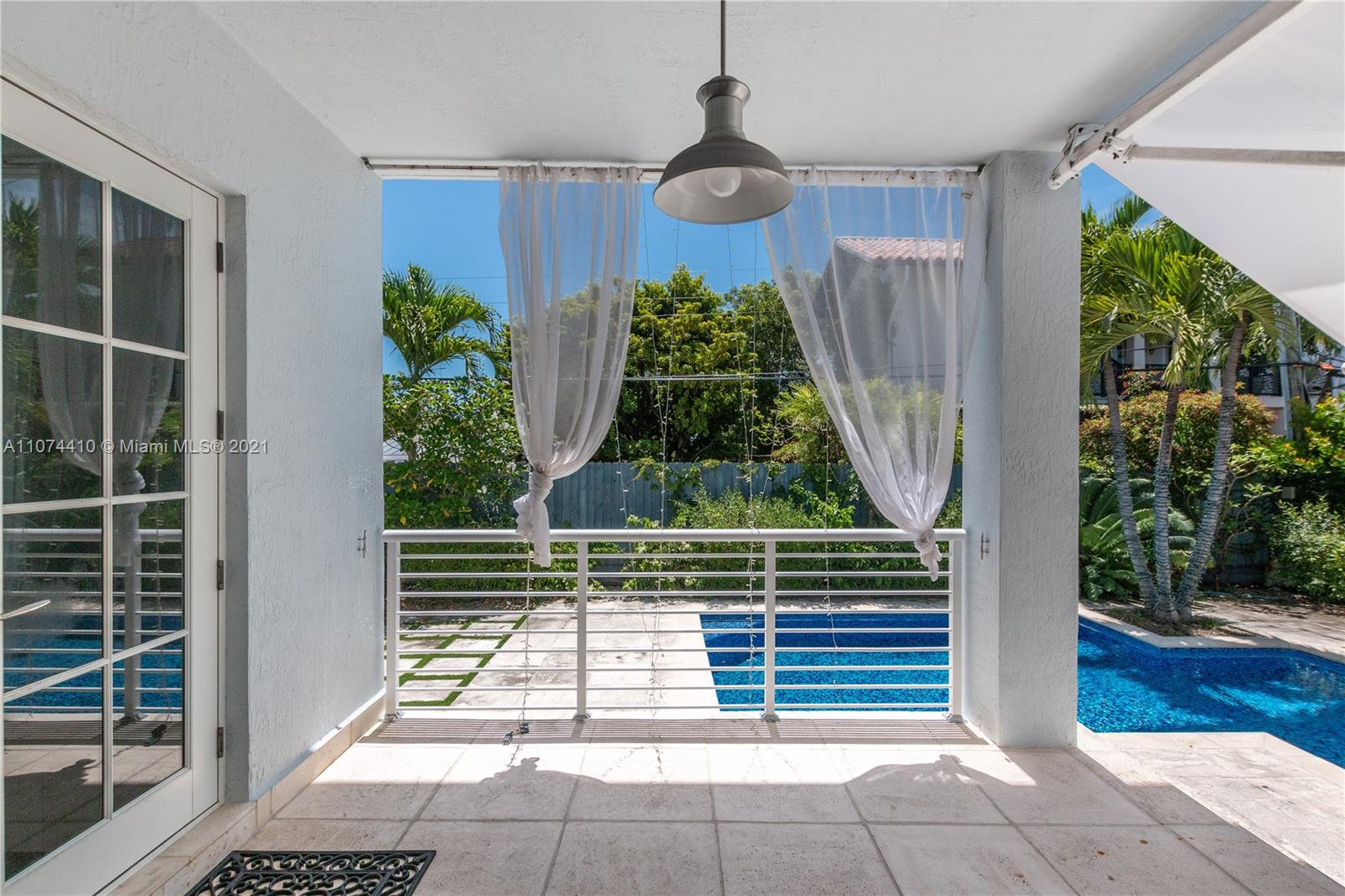Absolute charming elevated house in very quiet Street. 5/4 +DEN + Office . 3.500 Sq Ft plus 2 cars attached garage with A/C. High ceilings, full of light, great gourmet kitchen with den, walking closets in all bedrooms,. Fabulous outdoor space with pool.
