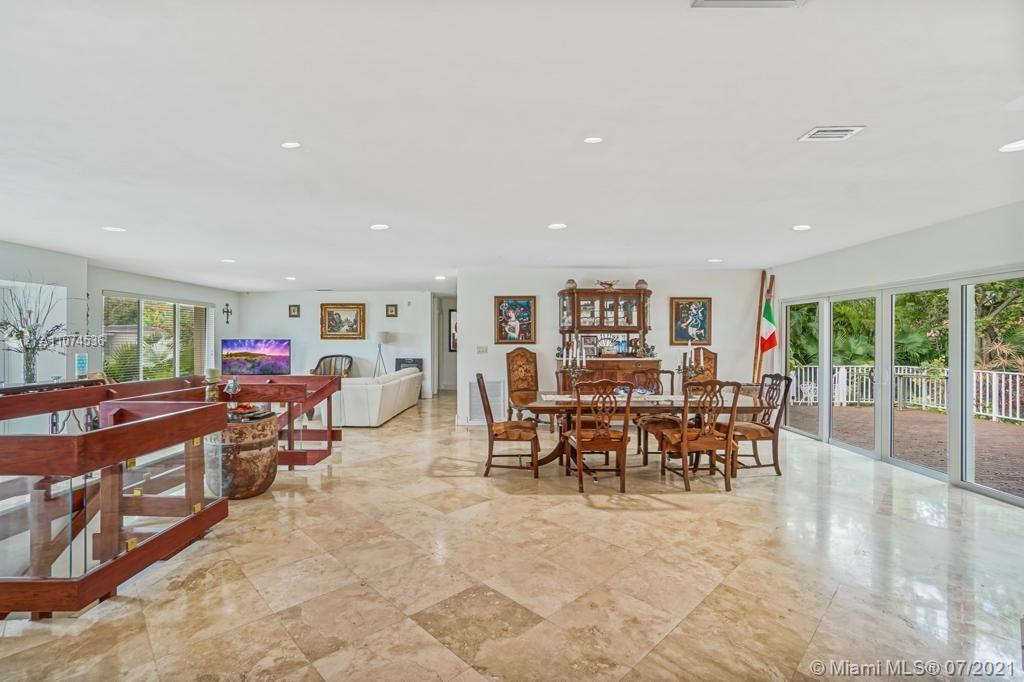 Truly unique Coral Gables home located walking distance to Miracle Mile! No flood zone. One of the few homes in Miami with a large protected concrete safe room DOWNSTAIRS from the ground floor (perfect for media room, wine cellar, gym, home office, hurricane shelter).  Downstairs shelter includes its own bathroom, kitchen and electrical box. This home also features an expansive open floor plan, new impact windows and door, updated kitchen with granite counter tops, marble floors, maid/in-laws quarters, and an elegant second story master suite equipped with its own private terrace. Enjoy mornings on the beautiful back patio surrounded by professionally landscaped back yard.  Enormous 2-car garage with high ceilings! Walk to Coral Gables restaurants!